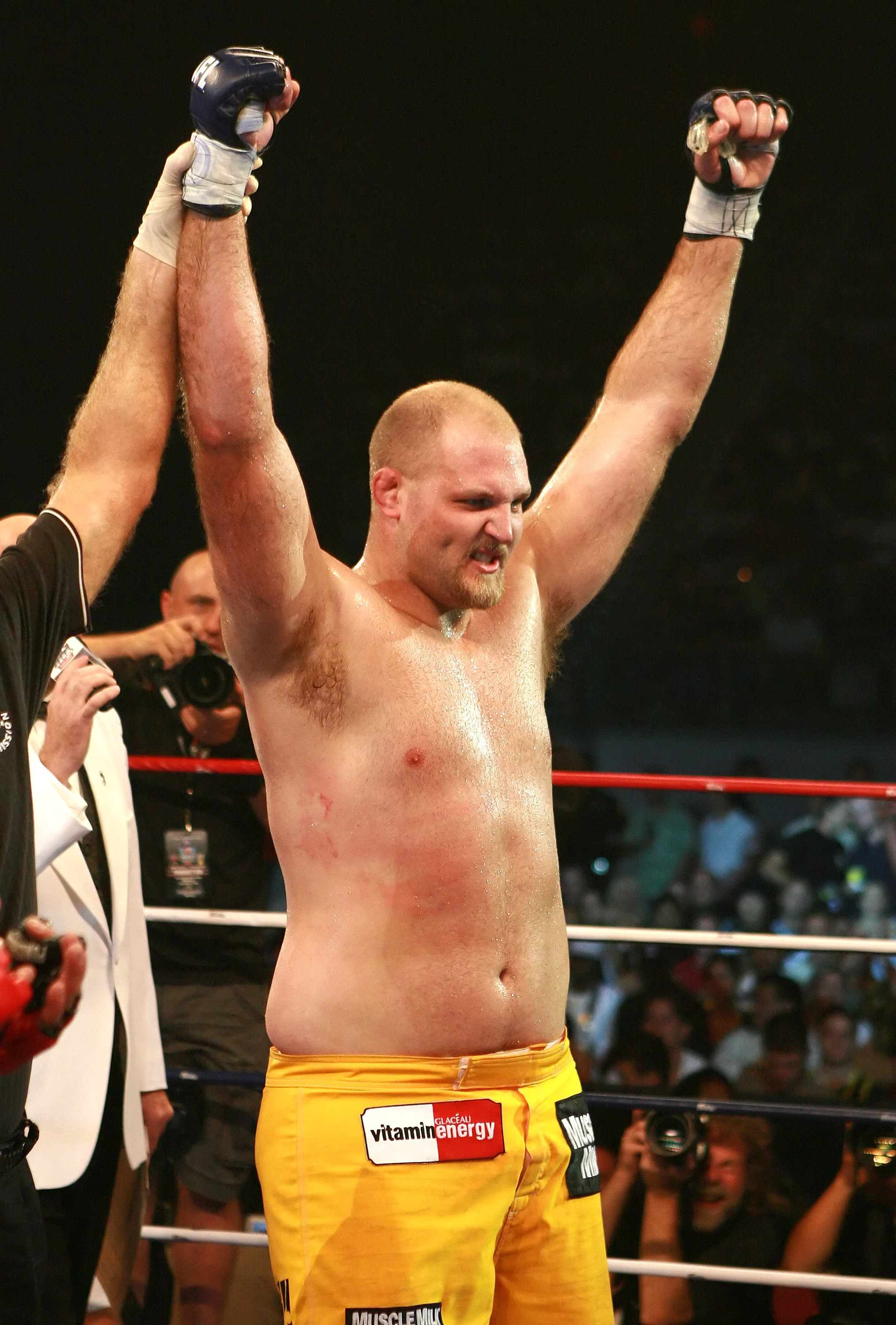 HOLLYWOOD, FL - SEPTEMBER 20:  Ben Rothwell (yellow trunks) celebrates his victory over Ricco Rodriguez during their heavyweight bout during the IFL finals at the Seminole Hard Rock Casino on September 20, 2007 in Hollywood, Florida.  (Photo by Doug Benc/