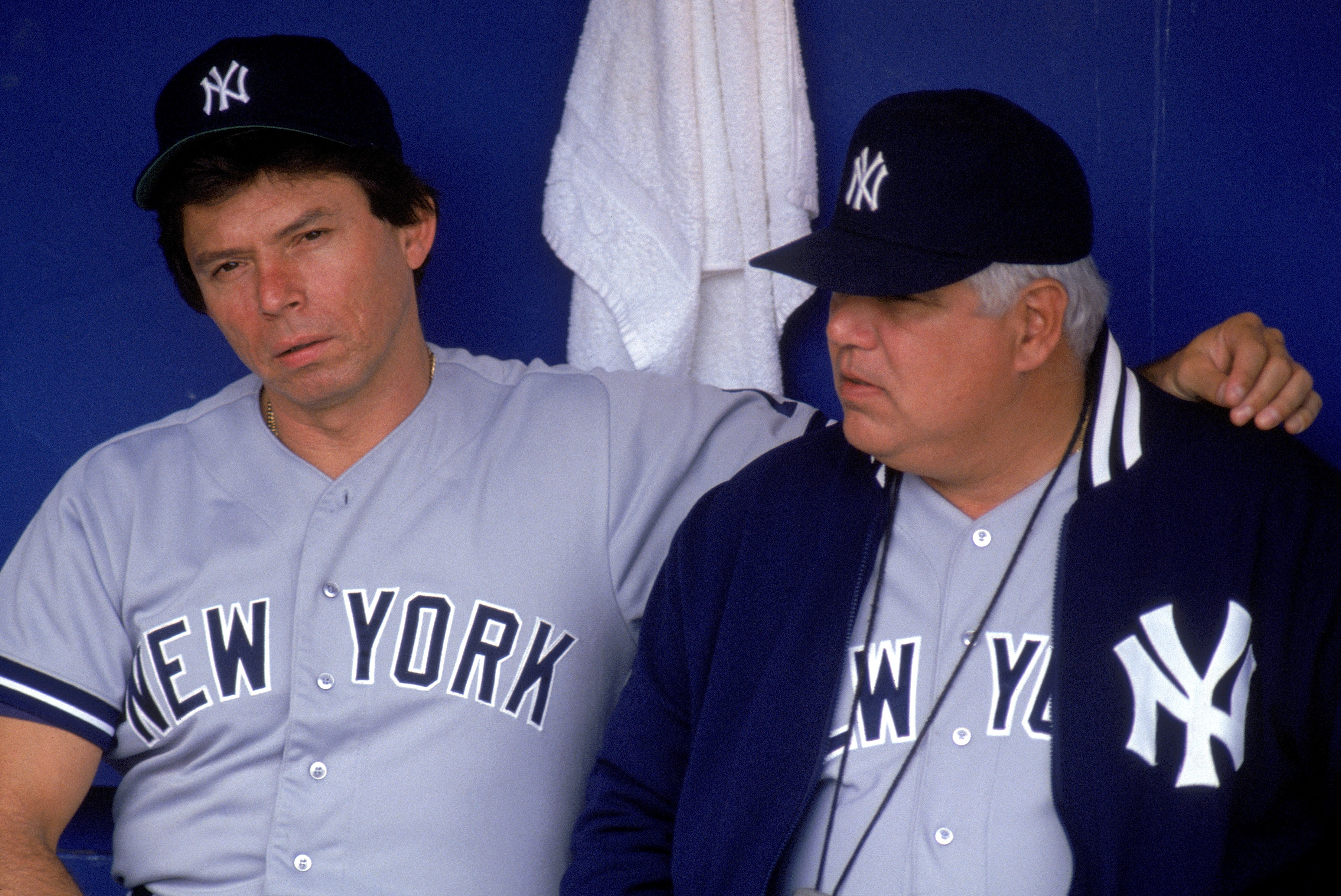 1990:  (L-R) Coach Darrell Evans and pitching coach Billy Connors of the New York Yankees sit in the dugout during a 1990 MLB season game.  (Photo by Jonathan Daniel/Getty Images