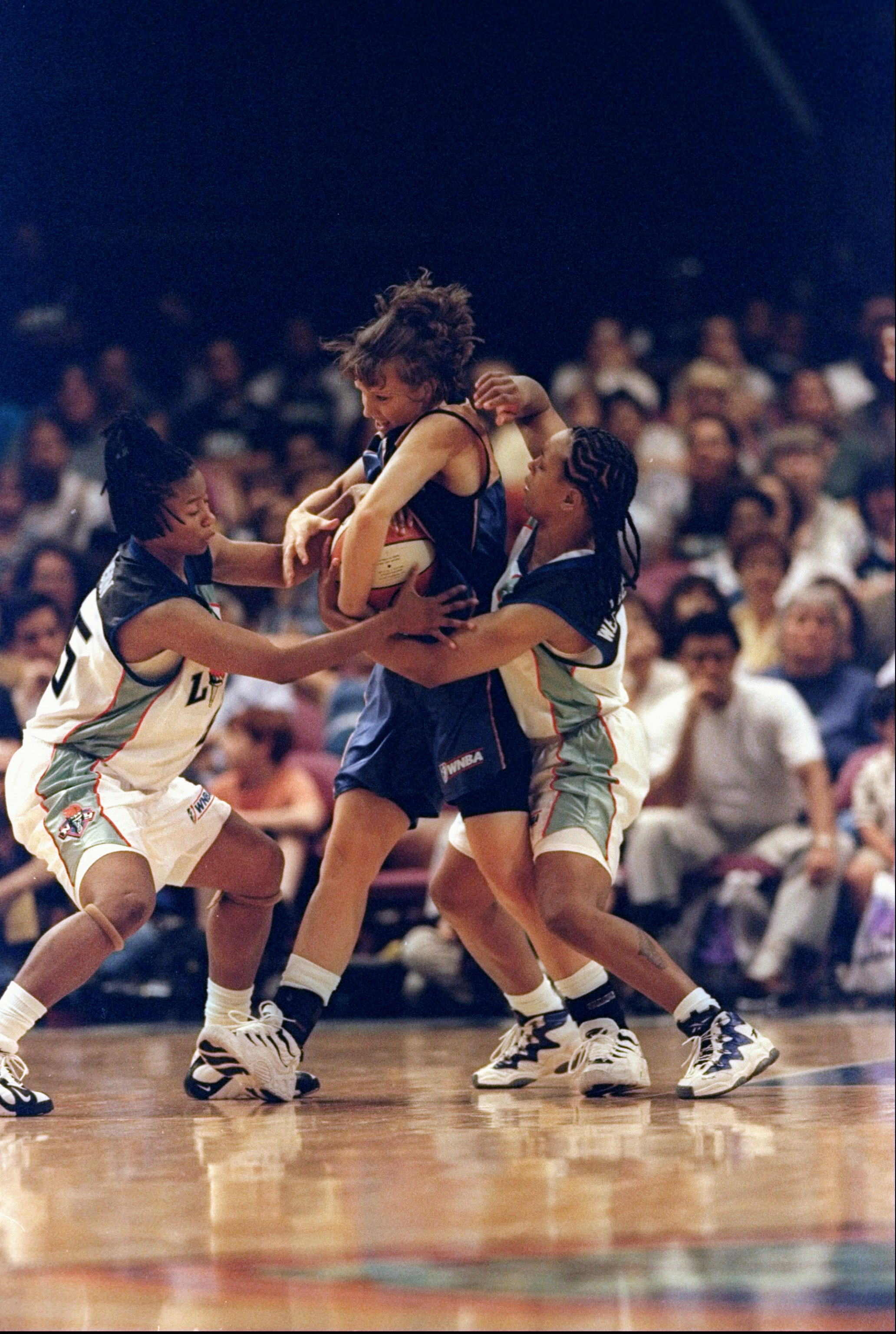 31 May 1998: Vickie Johnson #55 of the Washington Mysticsstruggles to keep the ball from Keri Chaconas and Teresa Weatherspoon of the New York Liberty during a preseason game at Madison Square Garden in New York, New York. the Mystics defeated the Liberty