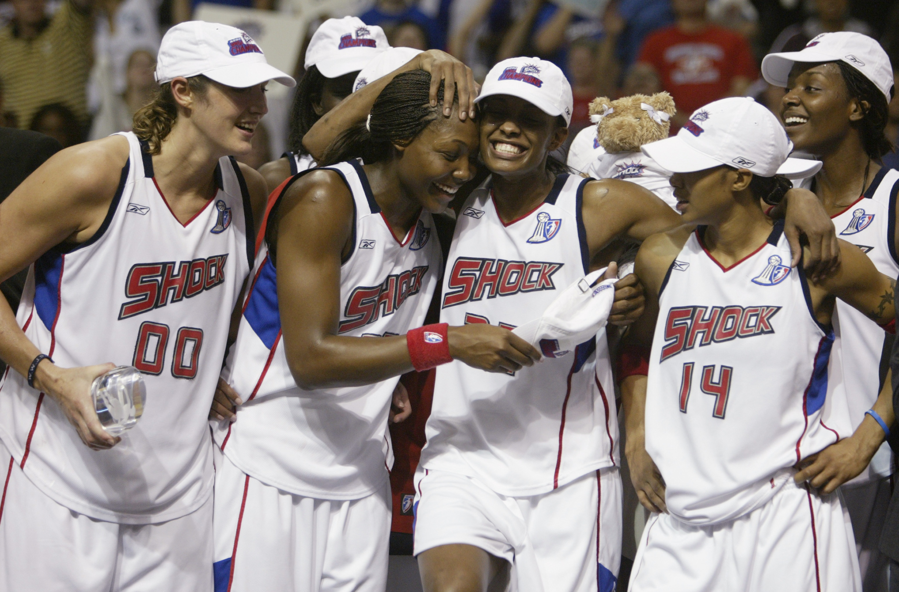 AUBURN HILLS, MI - SEPTEMBER 16:  (L to R) Ruth Riley #00, Cheryl Ford #35, Swin Cash #32, Deanna Nolan #14 and Barbara Ferris #54 of the Detroit Shock celebrate on the podium after defeating the two-time champion Los Angeles Sparks in Game three of the 2