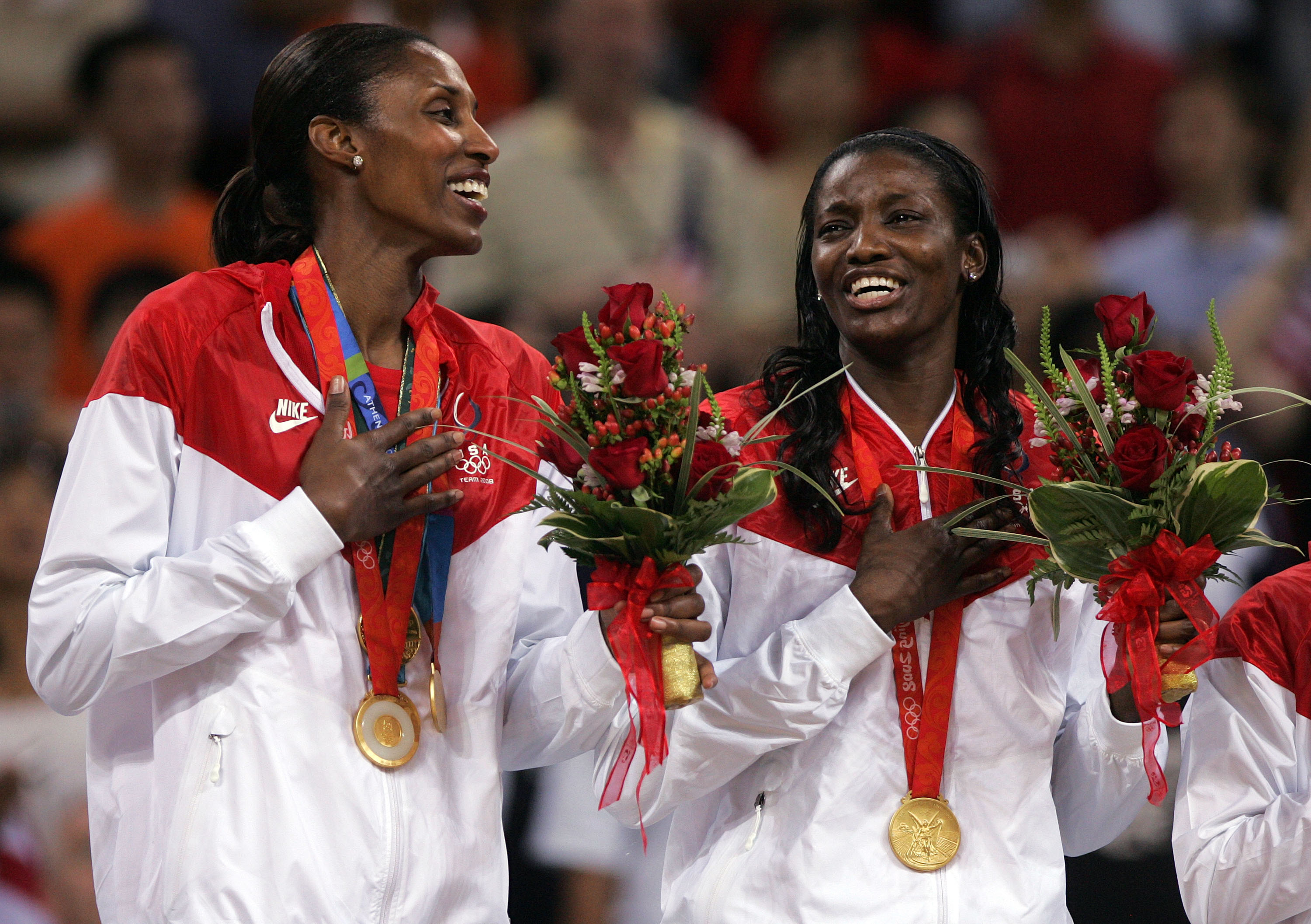 BEIJING - AUGUST 23:  Lisa Leslie and Delisha Milton-Jones celebrate after winning the gold medal against Australia at the Beijing Olympic Basketball Gymnasium on Day 15 of the Beijing 2008 Olympic Games on August 23, 2008 in Beijing, China.  (Photo by Je