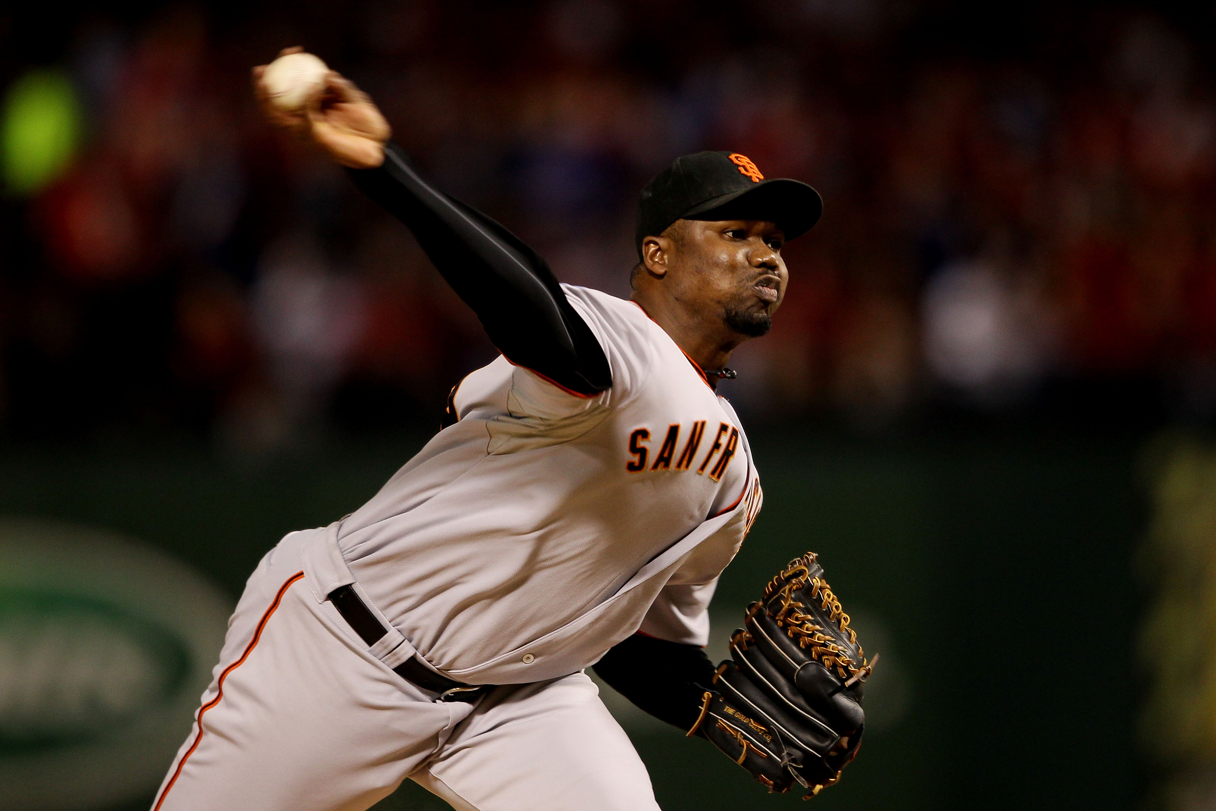 ARLINGTON, TX - OCTOBER 30:  Guillermo Mota #59 of the San Francisco Giants pitches against the Texas Rangers in Game Three of the 2010 MLB World Series at Rangers Ballpark in Arlington on October 30, 2010 in Arlington, Texas.  (Photo by Elsa/Getty Images