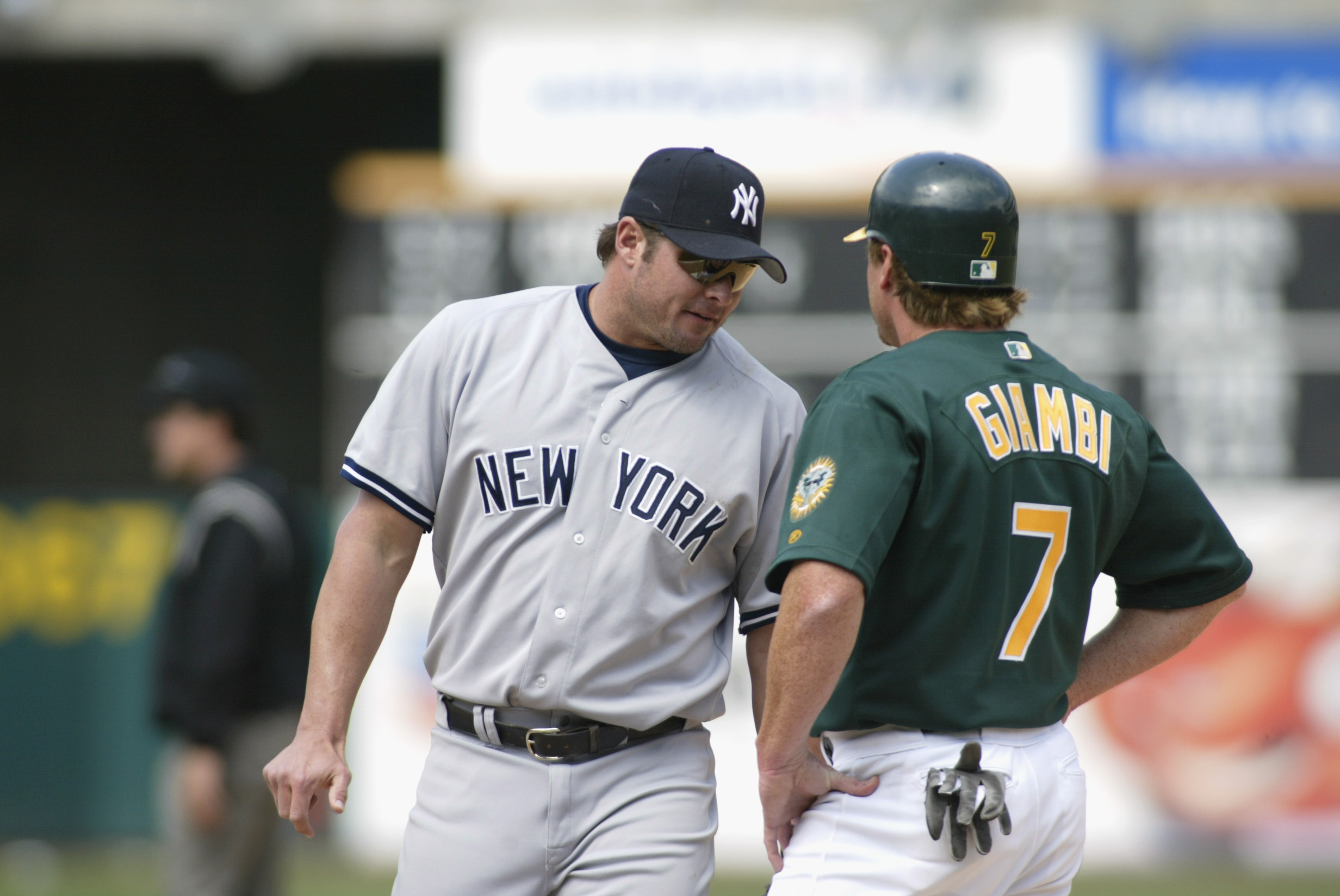 OAKLAND-APRIL 25: Jason Giambi #25 of the New York Yankees chats with brother Jeremy Giambi #7 of the Oakland A's during the game at Network Associates Coliseum in Oakland, California on April 25, 2002. The A's won 6-2. (Photo by Jed Jacobsohn/Getty Image
