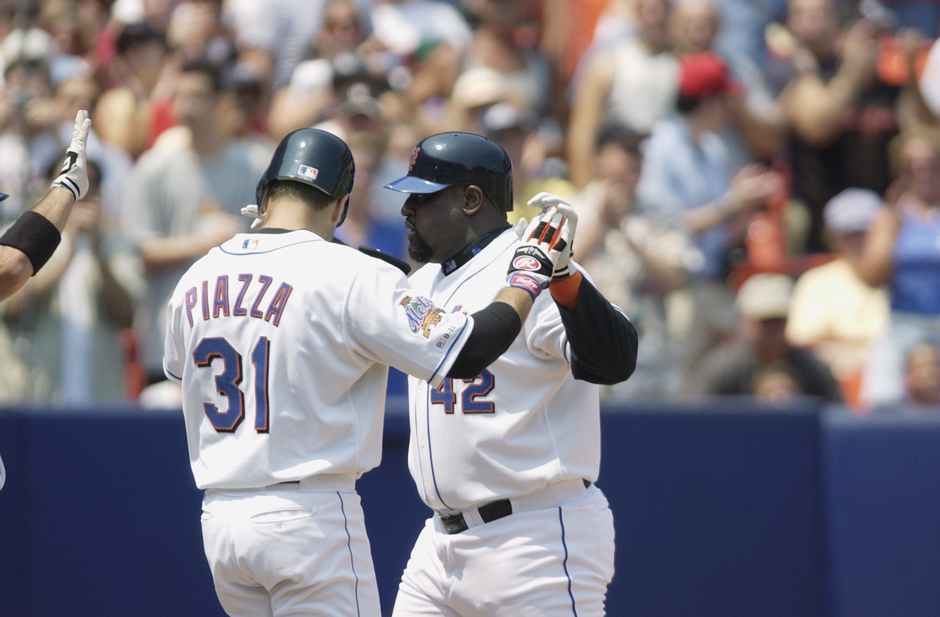 FLUSHING, NY - AUGUST 4:  First baseman Mo Vaughn #42 of the New York Mets receives congratulations from catcher Mike Piazza #31 after hitting a two-run home run during the MLB game against the Arizona Diamondbacks on August 4, 2002 at Shea Stadium in Flu