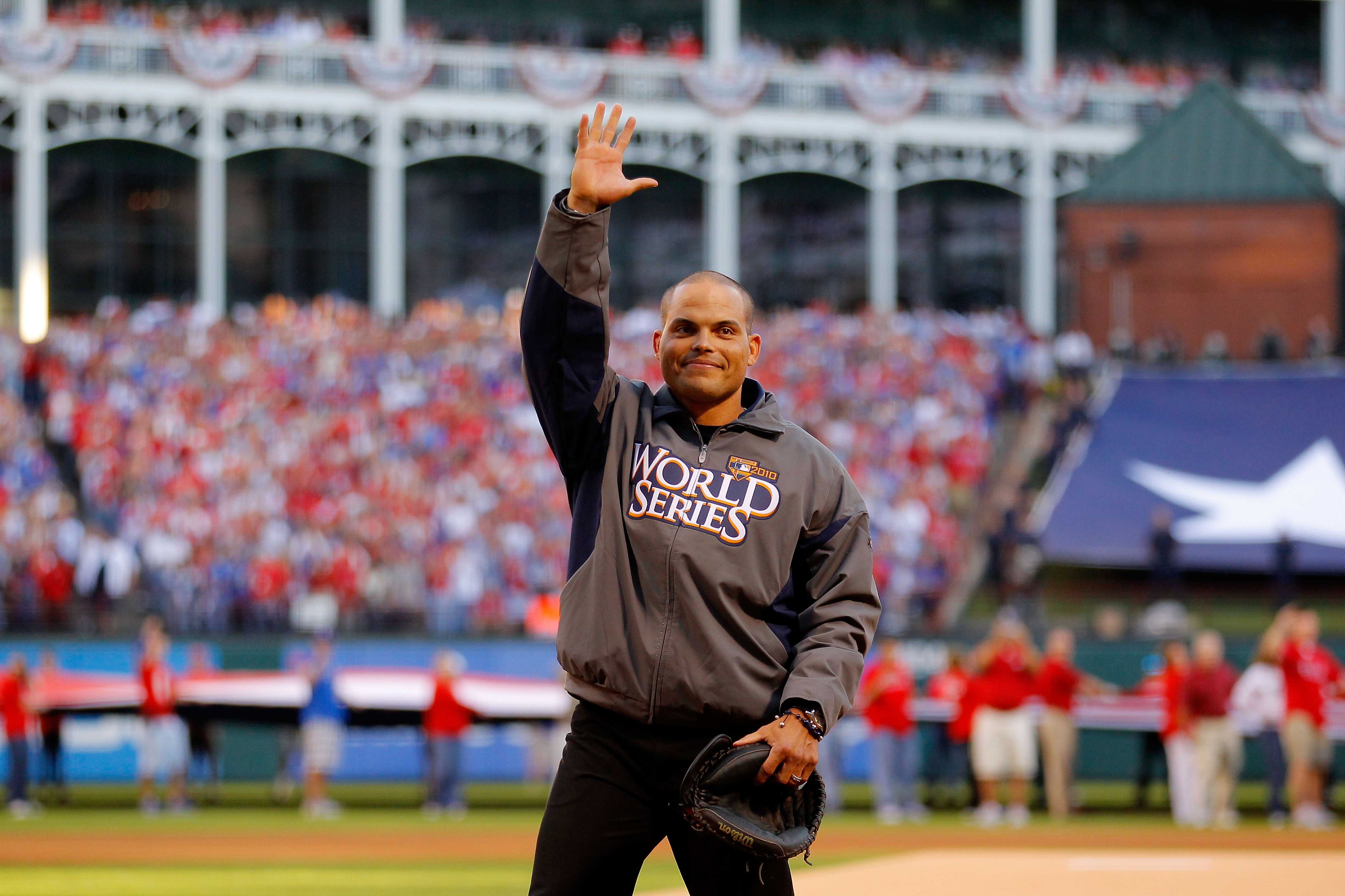 ARLINGTON, TX - OCTOBER 30: Former catcher for the Texas Rangers Ivan 'Pudge' Rodriguez waves to the fans as he walks out ot catch the cermonial firts pitch from Rangers team President Nolan Ryan against the San Francisco Giants in Game Three of the 2010