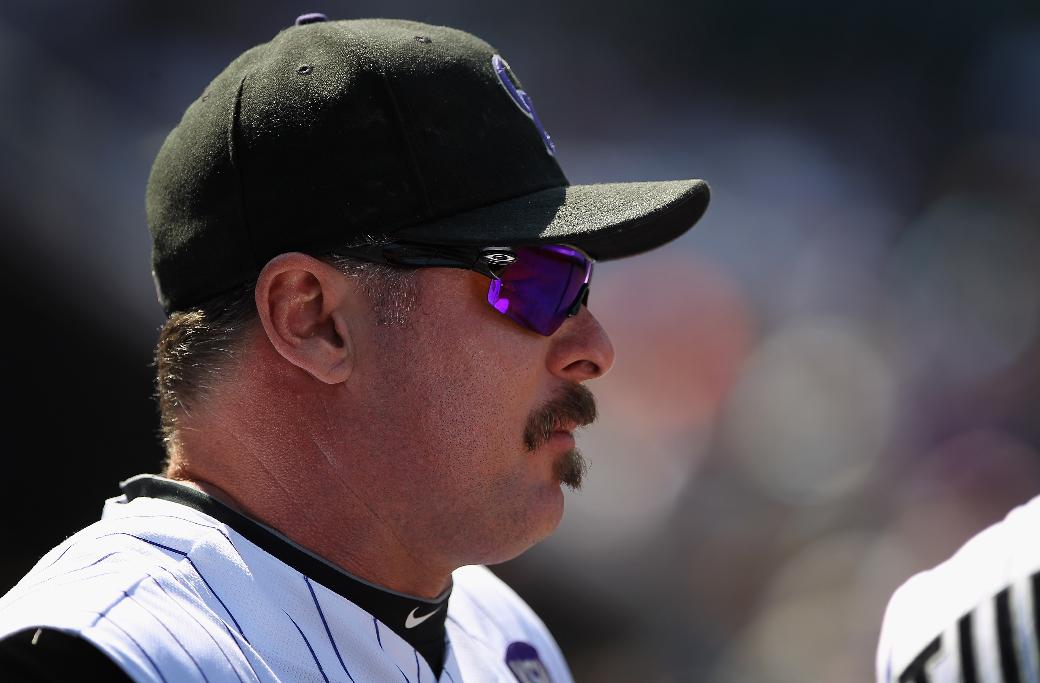 DENVER - SEPTEMBER 15:  Jason Giambi #23 of the Colorado Rockies looks on from the dugout against the San Diego Padres at Coors Field on September 15, 2010 in Denver, Colorado. The Rockies defeated the Padres 9-6.  (Photo by Doug Pensinger/Getty Images)