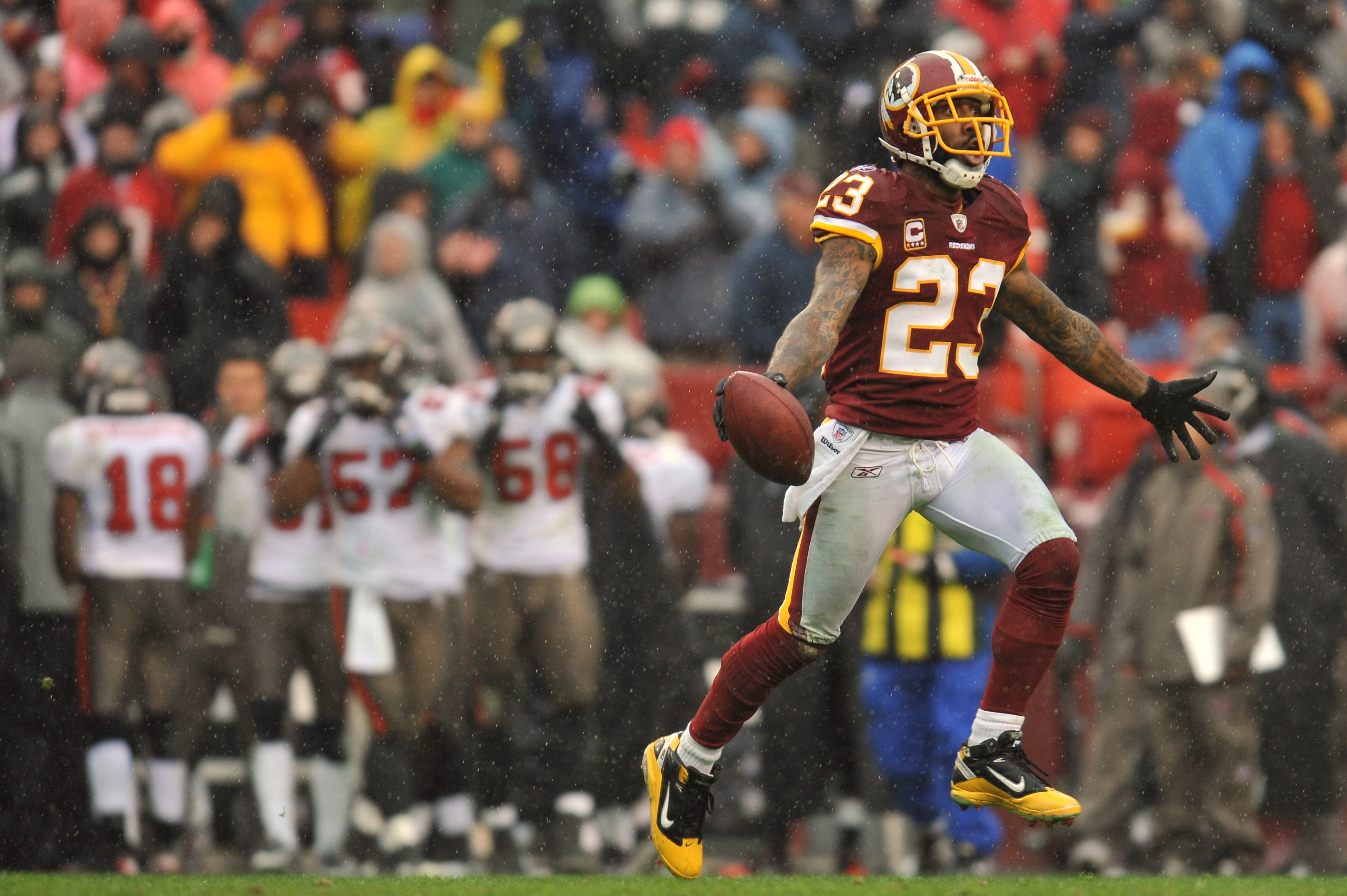 LANDOVER, MD - DECEMBER 12:  DeAngelo Hall #23 of the Washington Redskins celebrates a fumble recovery that lead to a touchdown against the Tampa Bay Buccaneers at FedExField on December 12, 2010 in Landover, Maryland. The Redskins lead the Buccaneers at