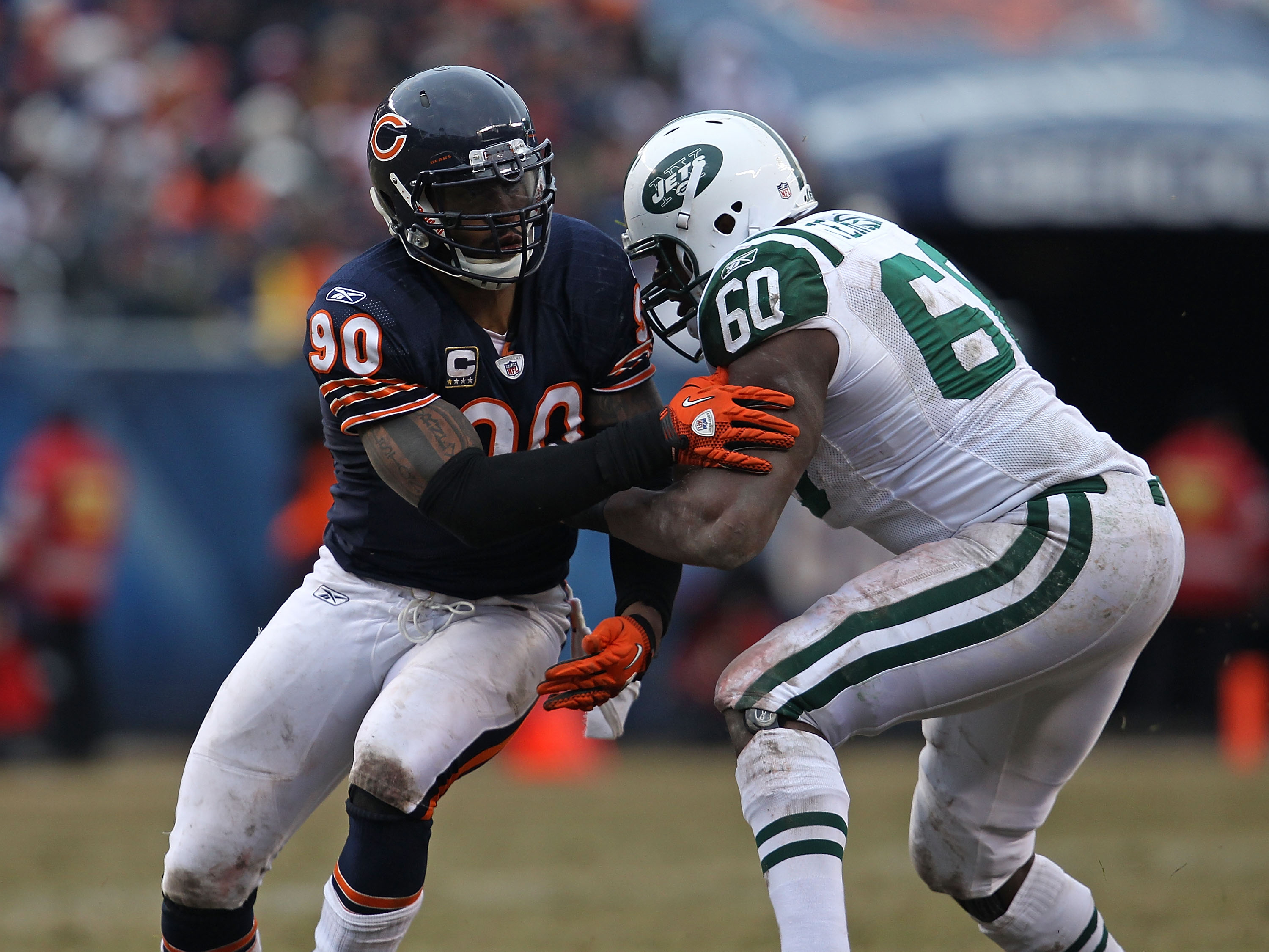 CHICAGO, IL - DECEMBER 26: Julius Peppers #90 of the Chicago Bears rushes against D' Brickashaw Ferguson #60 of the New York Jets at Soldier Field on December 26, 2010 in Chicago, Illinois. The Bears defeated the Jets 38-34. (Photo by Jonathan Daniel/Gett