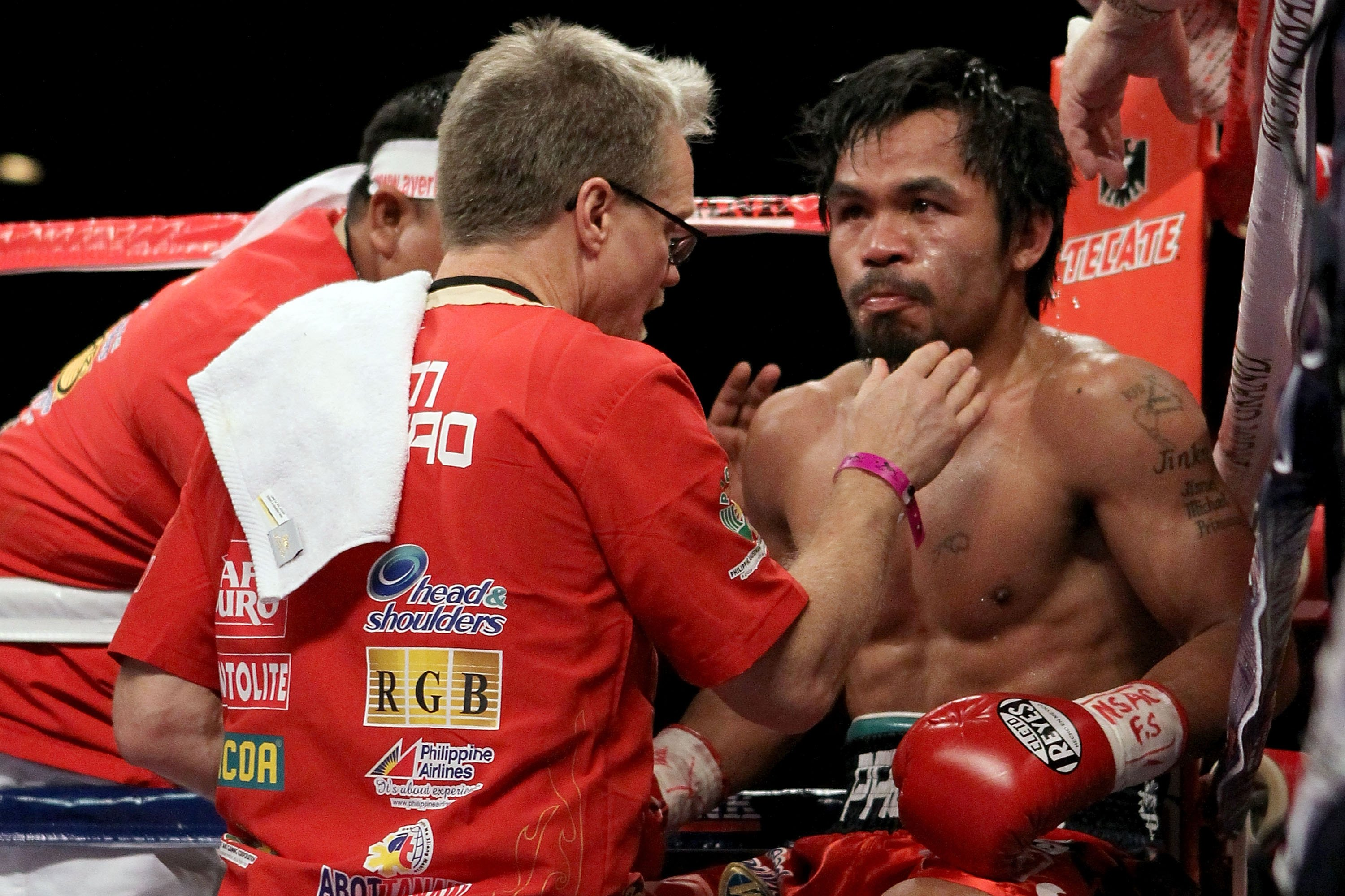 LAS VEGAS - NOVEMBER 14:  Manny Pacquiao sits in his corner between rounds with trainer Freddie Roach against Miguel Cotto during their WBO welterweight title fight at the MGM Grand Garden Arena on November 14, 2009 in Las Vegas, Nevada.  (Photo by Al Bel