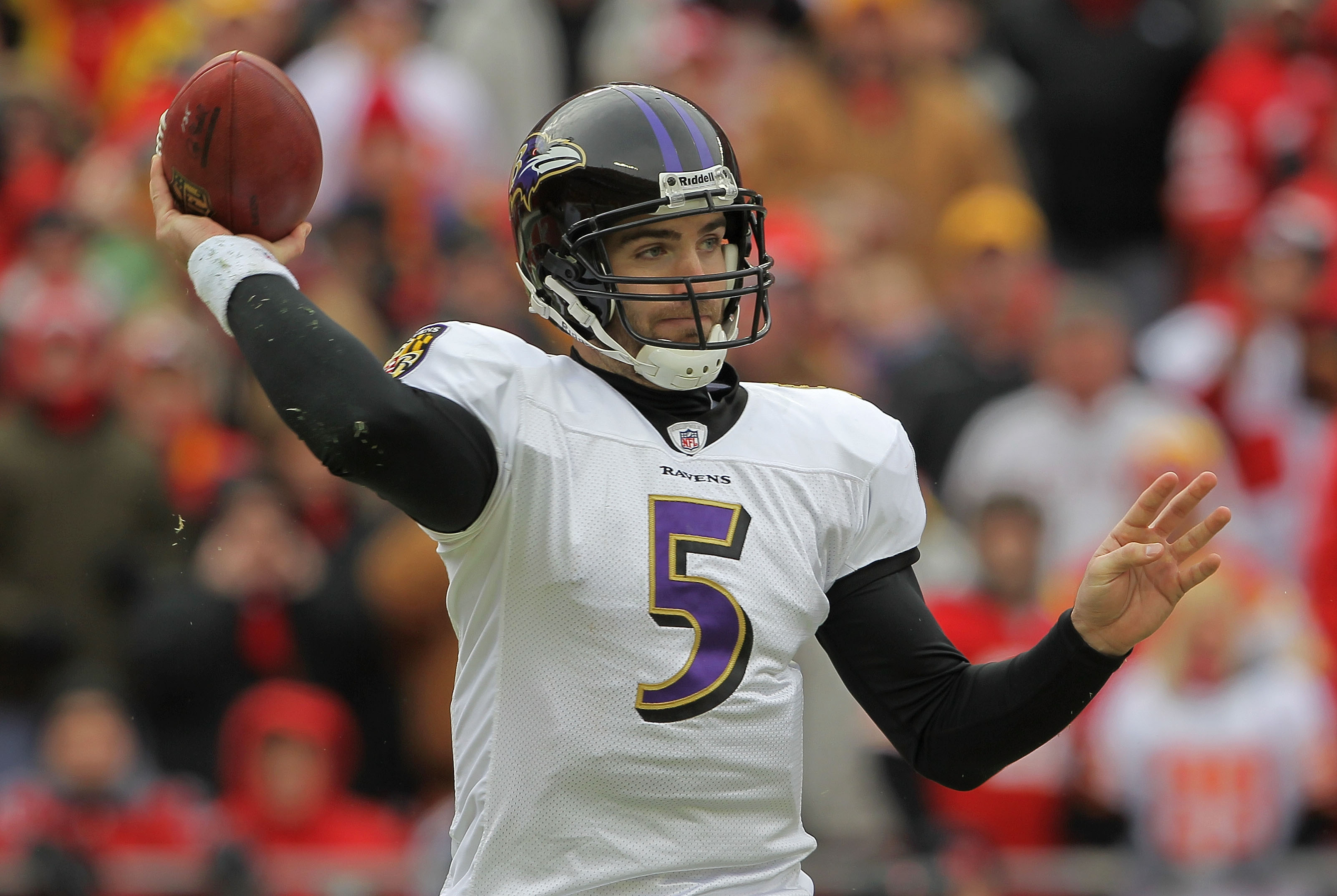 KANSAS CITY, MO - JANUARY 09:  Quarterback Joe Flacco #5 of the Baltimore Ravens throws a pass against the Kansas City Chiefs in their 2011 AFC wild card playoff game at Arrowhead Stadium on January 9, 2011 in Kansas City, Missouri.  (Photo by Doug Pensin
