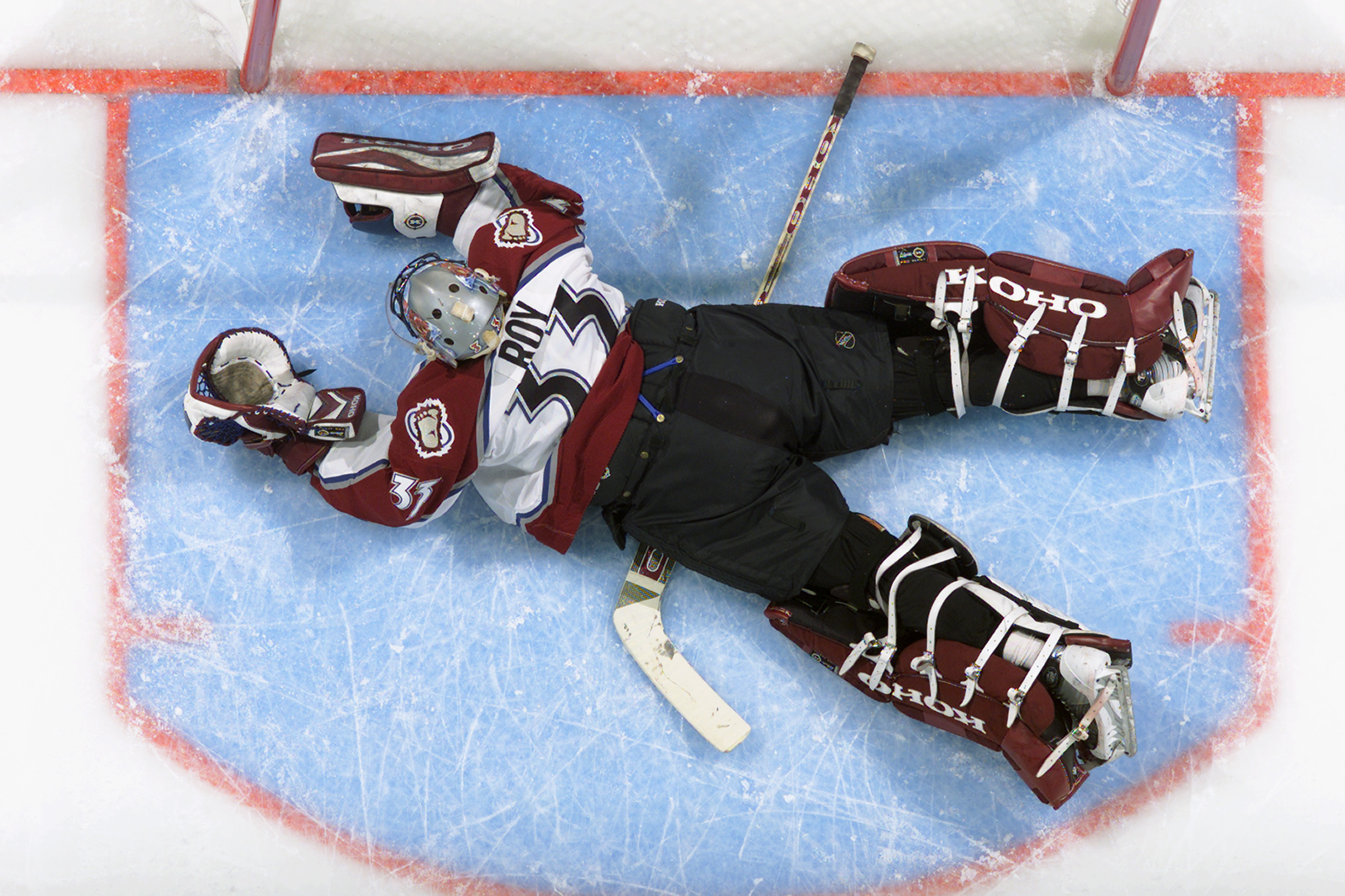 DENVER - APRIL 19:  Goalie Patrick Roy #33 of the Colorado Avalanche dives but can't stop Patrick Kuba of the Minnesota Wild from scoring during game five of the first round of the 2003 Western Conference Stanley Cup playoffs on April 19, 2003 at the Peps