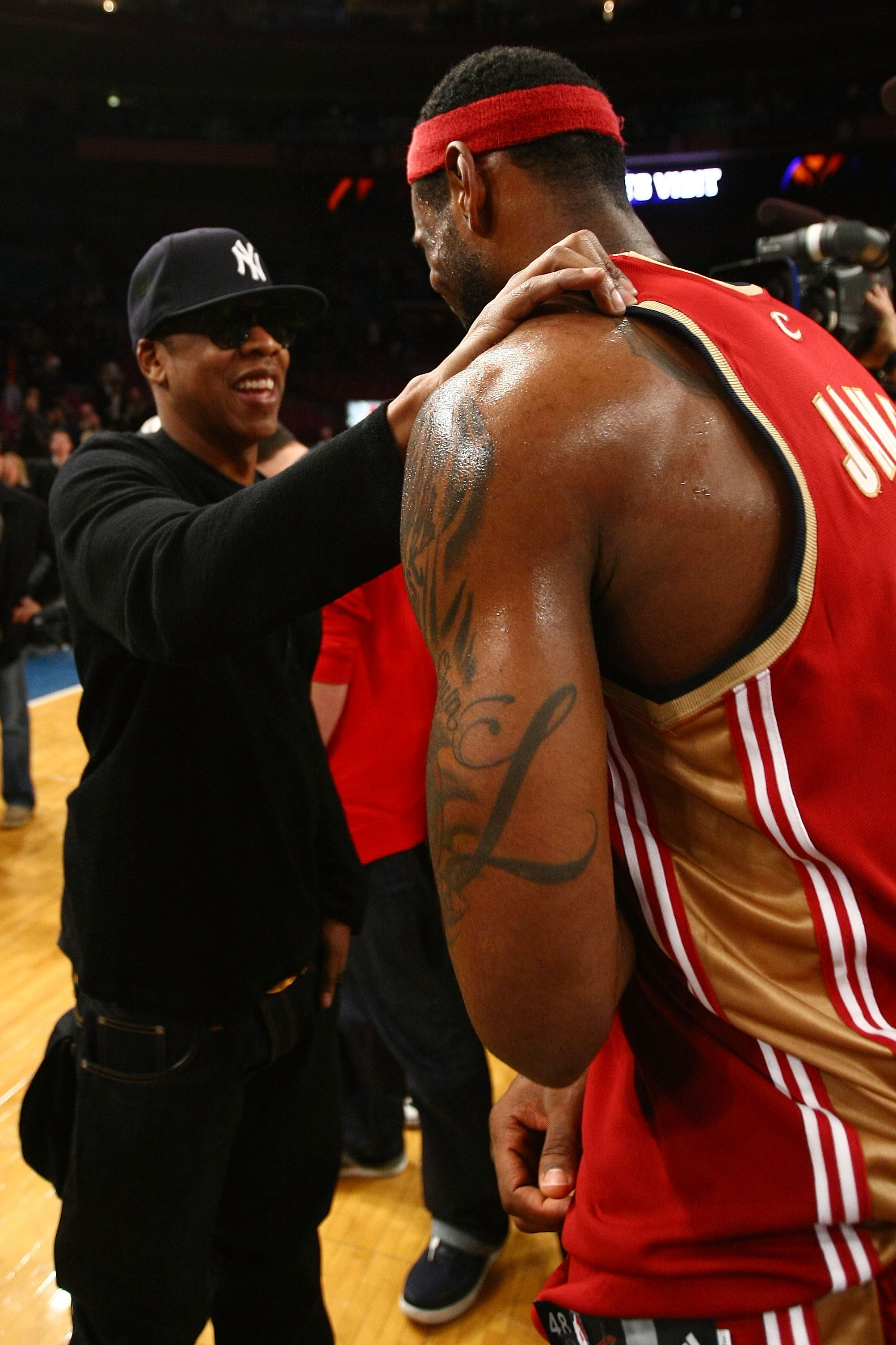 NEW YORK - NOVEMBER 06:  Hip Hop artist Jay-Z shakes hands with LeBron James #23 of the Cleveland Cavaliers after defeating the New York Knicks at Madison Square Garden November 6, 2009 in New York City. NOTE TO USER: User expressly acknowledges and agree