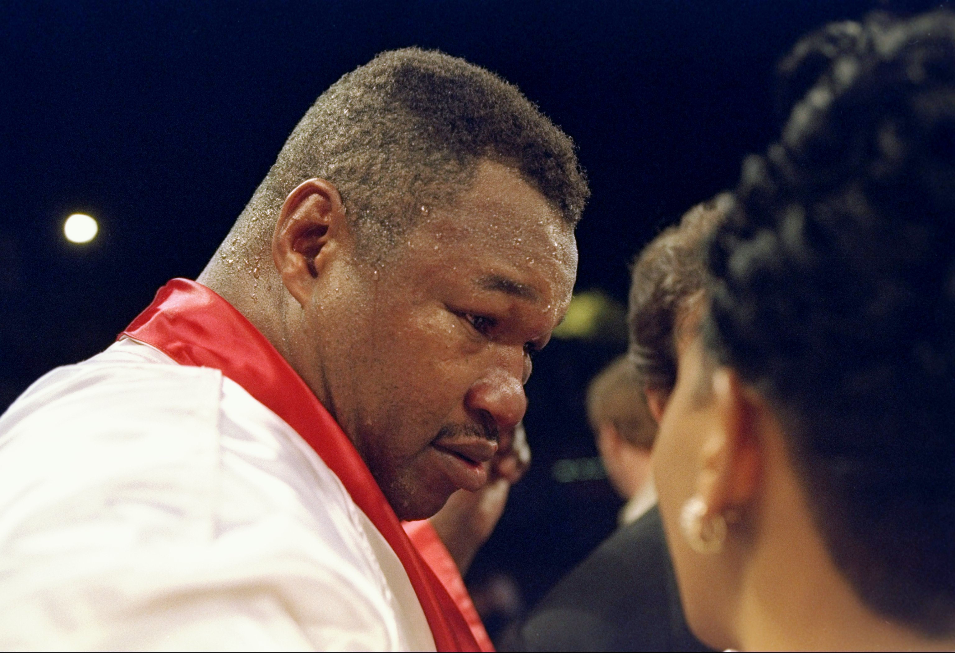 8 Apr 1995: Larry Holmes (right) looks on during his fight against Oliver McCall in Las Vegas, Nevada. McCall won the bout with an unanimous decision after 12 rounds.