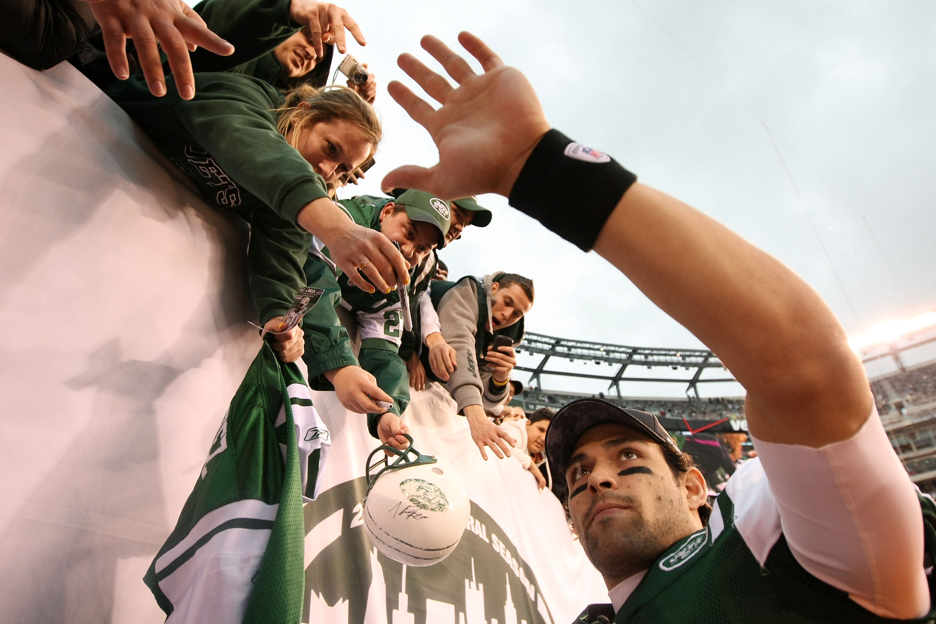 EAST RUTHERFORD, NJ - JANUARY 02:  Quarterback Mark Sanchez #6 of the New York Jets celebrates with fans after they defeated the Buffalo Bills 38 to 7 at New Meadowlands Stadium on January 2, 2011 in East Rutherford, New Jersey.  (Photo by Al Bello/Getty