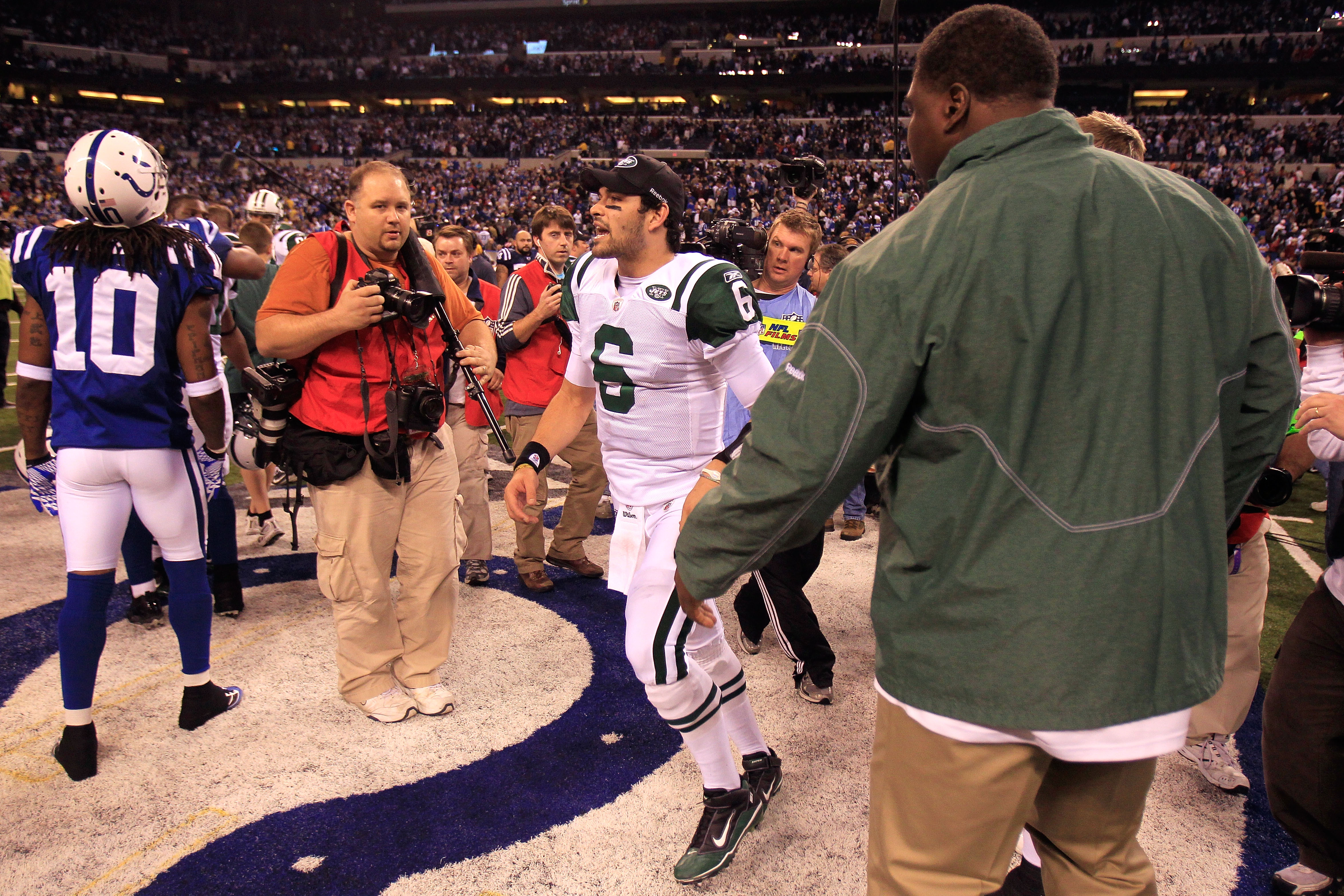 INDIANAPOLIS, IN - JANUARY 08:  Quarterback Mark Sanchez #6 of the New York Jets celebrates as he walks off the field after the Jets won 17-16 against the Indianapolis Colts during their 2011 AFC wild card playoff game at Lucas Oil Stadium on January 8, 2