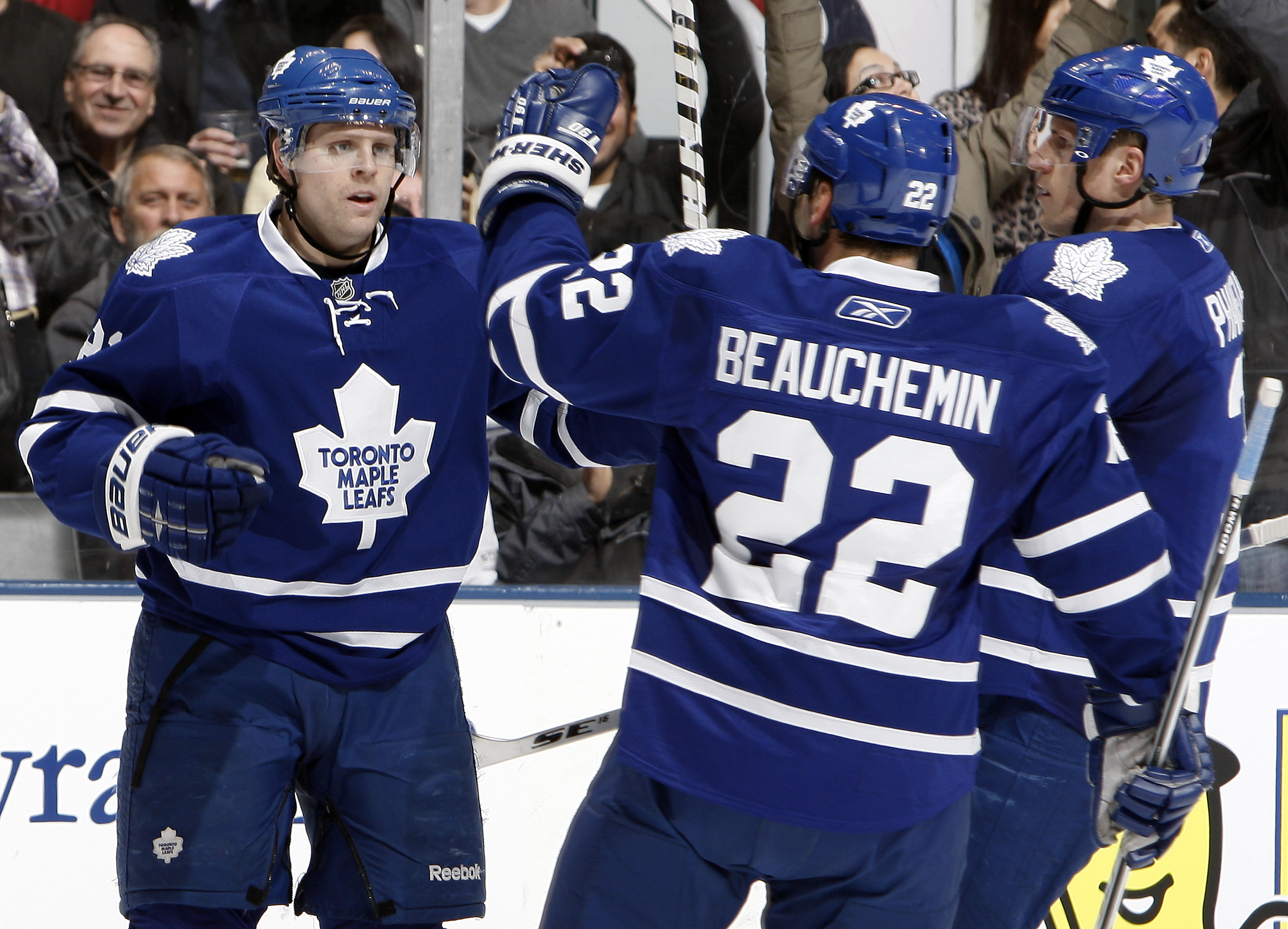 TORONTO, CANADA - JANUARY 6: Phil Kessel #81, Francois Beauchemin #22  and Dion Phaneuf #3 of the Toronto Maple Leafs celebrate Phil Kessel goal against the St. Louis Blues during game action at the Air Canada Centre January 6, 2011 in Toronto, Ontario, C