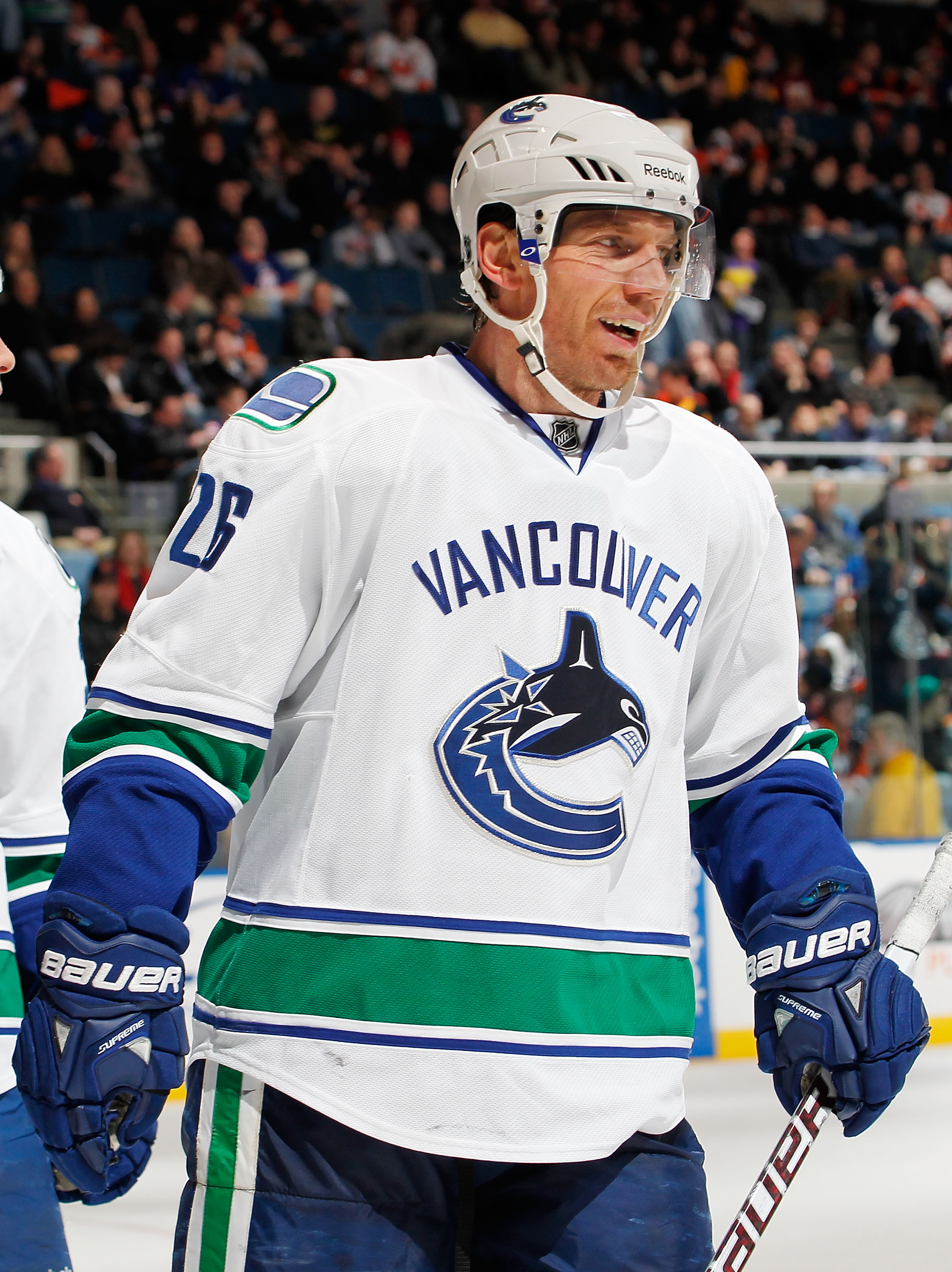 UNIONDALE, NY - JANUARY 11:  Mikael Samuelsson #26 of the Vancouver Canucks  sksmiles after a Vancouver goal during an NHL game against the New York Islanders at Nassau Coliseum on January 11, 2011 in Uniondale, New York.  (Photo by Paul Bereswill/Getty I