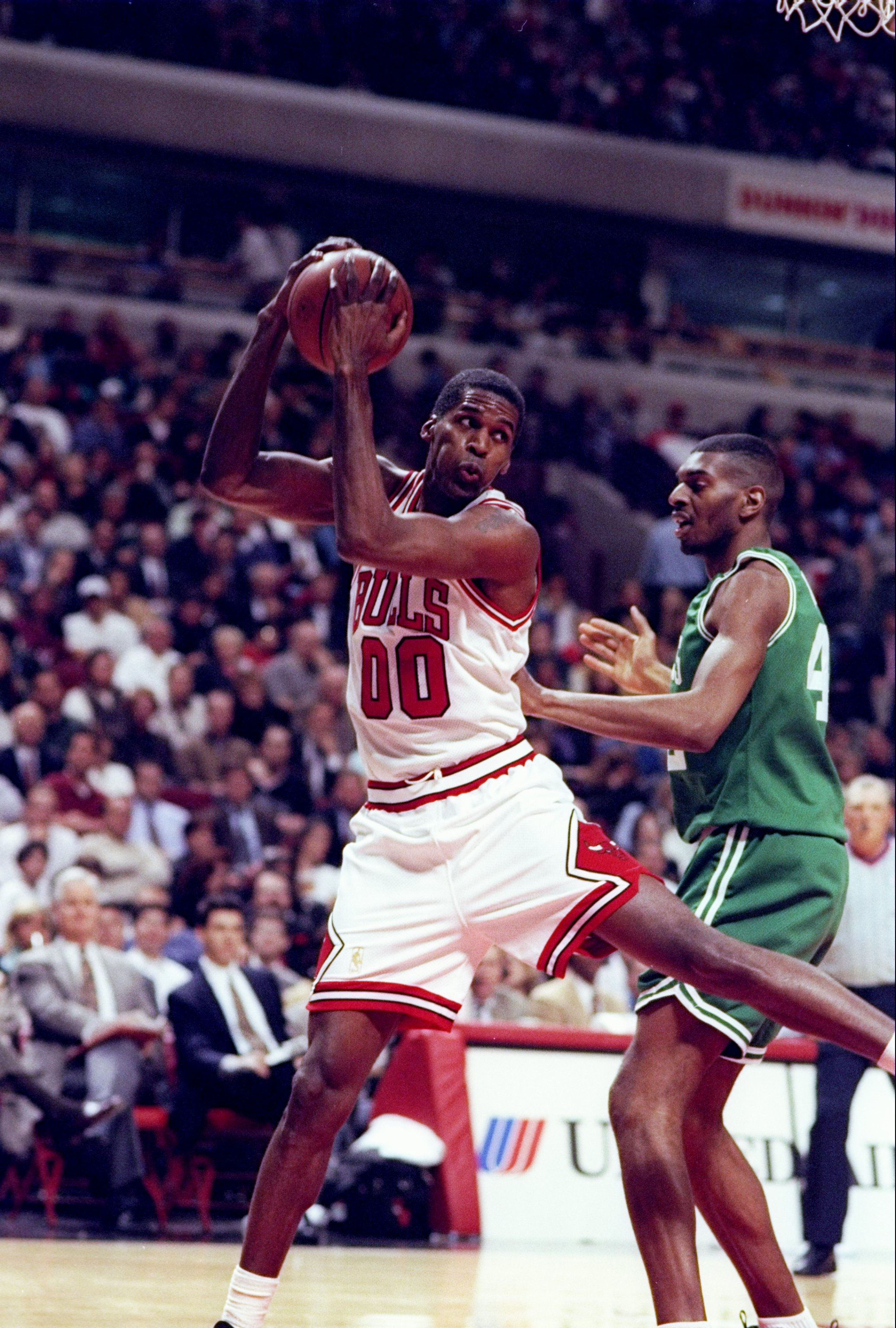 1 Apr 1997:  Center Robert Parish of the Chicago Bulls (left)  in action against center Steve Hamer of the Boston Celtics during a game at the United Center in Chicago, Illinois.  The Bulls won the game 111-106. Mandatory Credit: Jonathan Daniel  /Allspor
