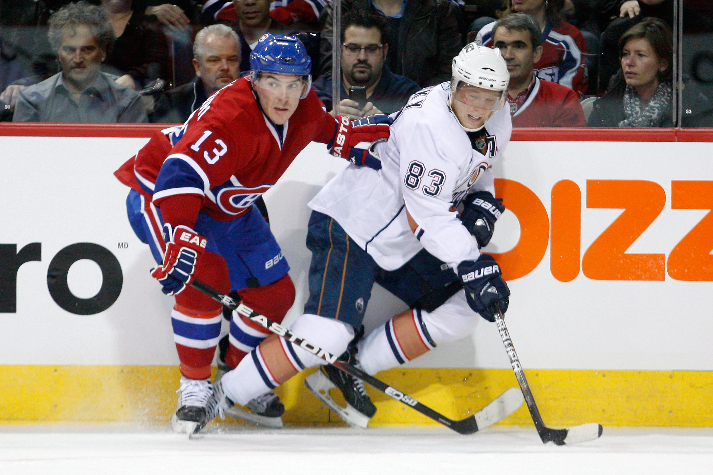 MONTREAL, CANADA - DECEMBER 01:  Mike Cammalleri #13 of the Montreal Canadiens and Ales Hemsky #83 of the Edmonton Oilers battle for position during the NHL game at the Bell Centre on December 1, 2010 in Montreal, Quebec, Canada.  The Oilers defeated the