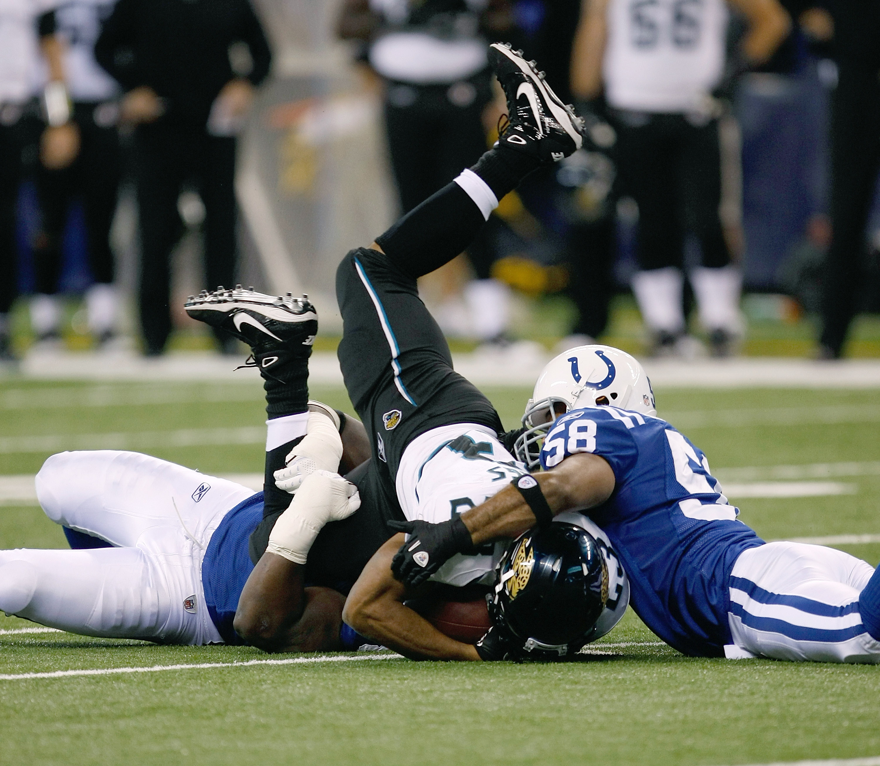 INDIANAPOLIS, IN - DECEMBER 19: Maurice Jones-Drew #32 of the Jacksonville Jaguars is upended by Gary Brackett #58 of the Indianapolis Colts at Lucas Oil Stadium on December 19, 2010 in Indianapolis, Indiana.  (Photo by Scott Boehm/Getty Images)