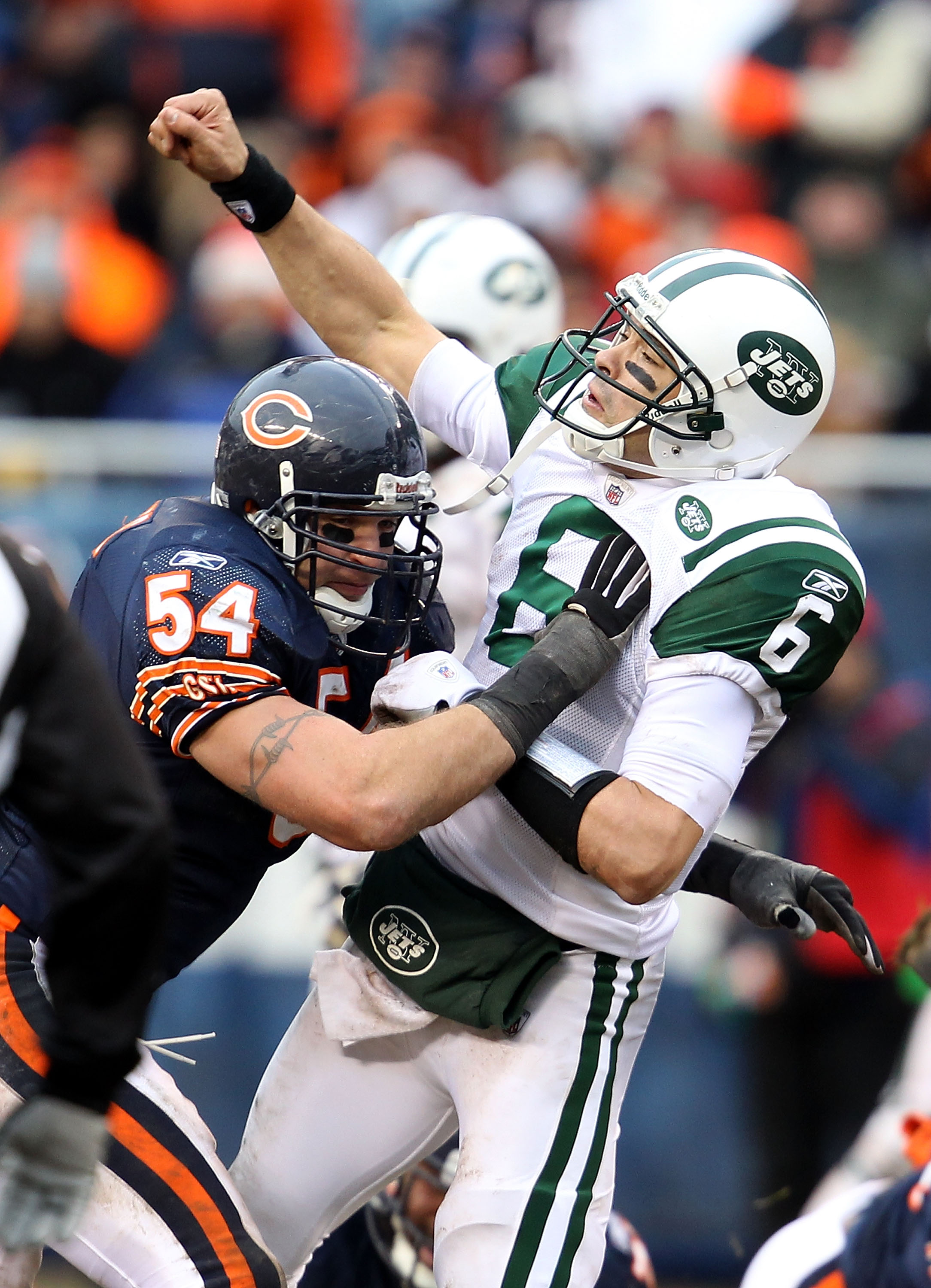 CHICAGO, IL - DECEMBER 26: Brian Urlacher #54 of the Chicago Bears hits Mark Sanchez #6 of the New York Jets at Soldier Field on December 26, 2010 in Chicago, Illinois. The Bears defeated the Jets 38-34. (Photo by Jonathan Daniel/Getty Images)