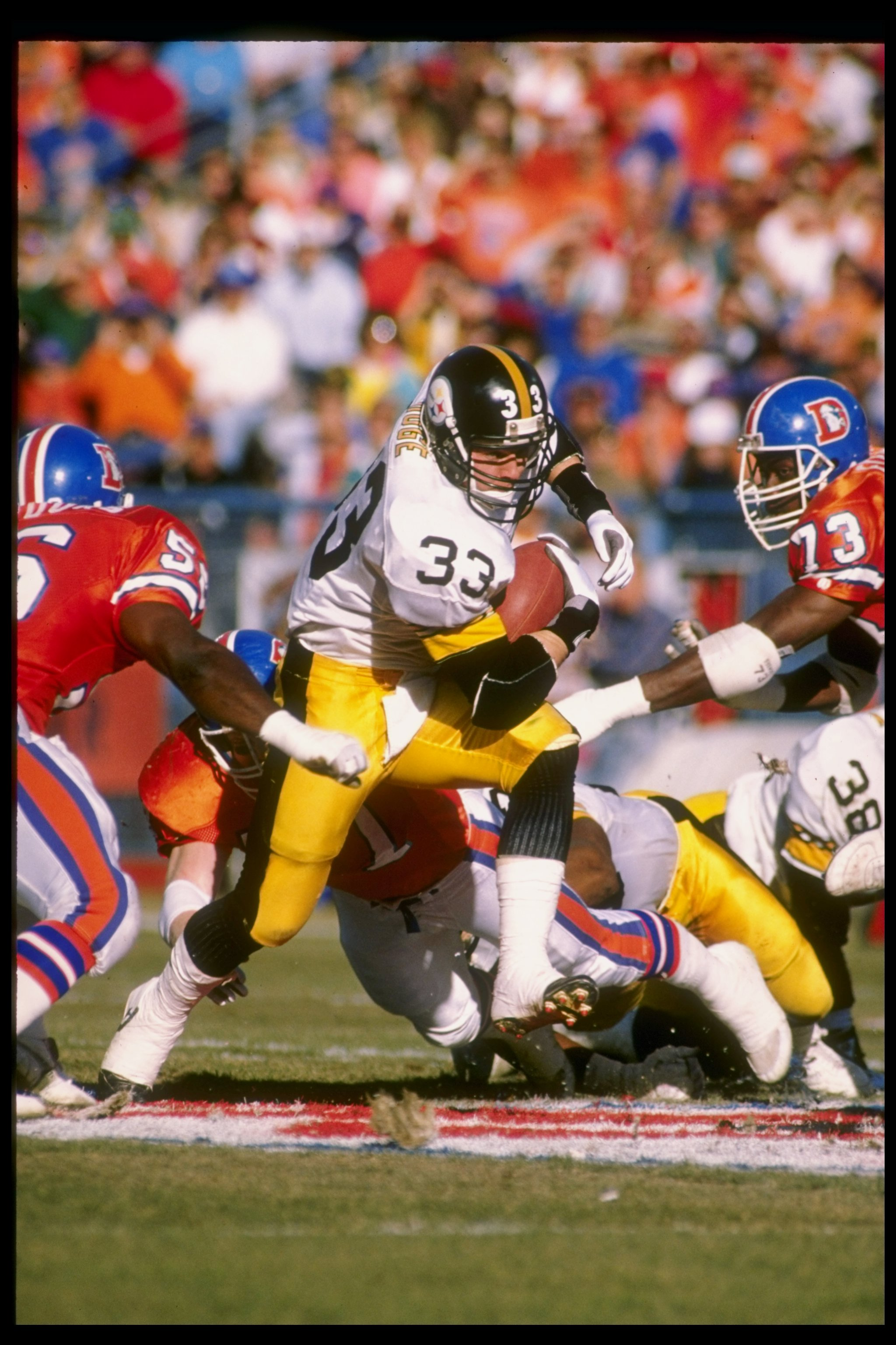 a88f20e1c 7 Jan 1990  Fullback Merrill Hoge of the Pittsburgh Steelers runs with the  ball during