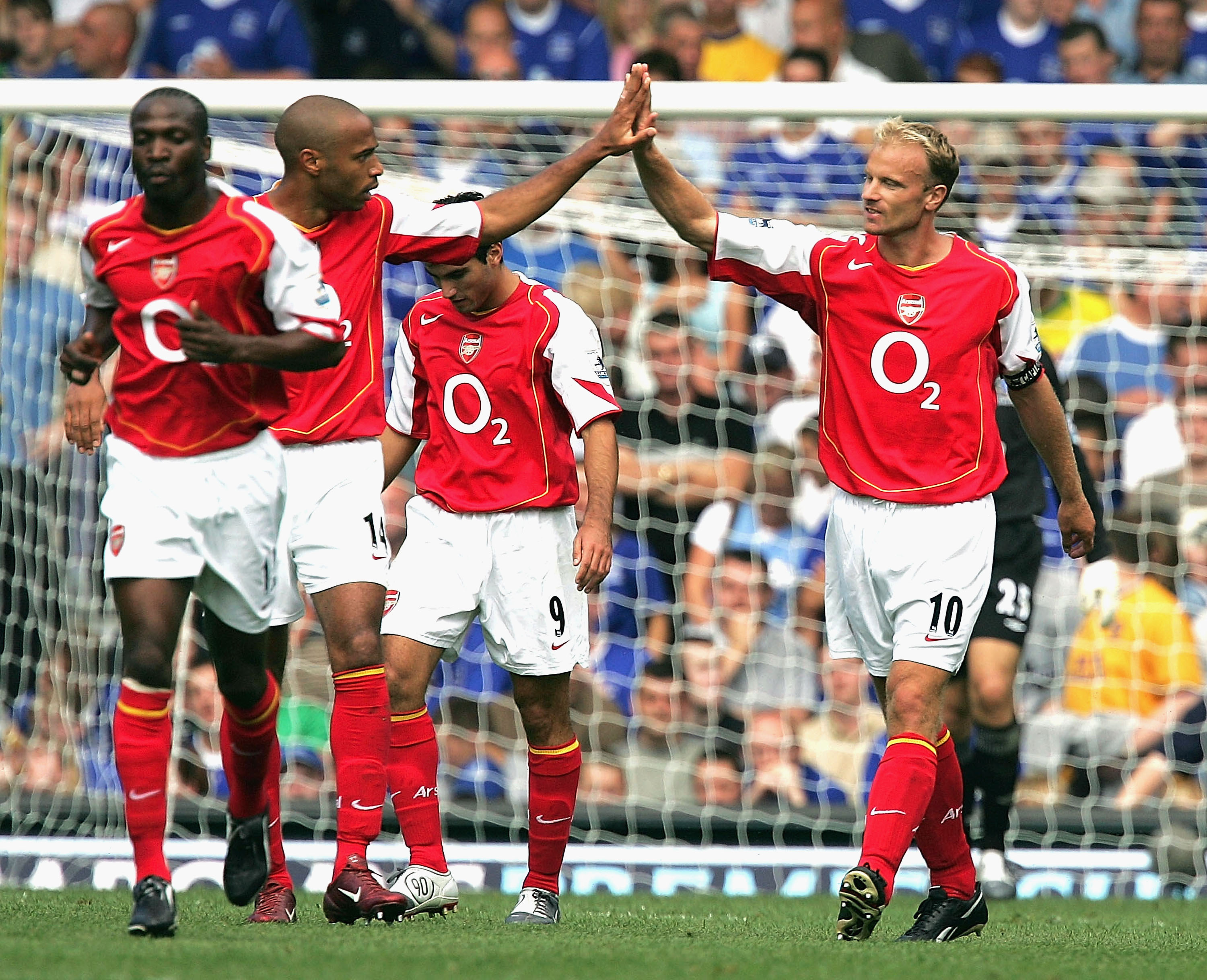 EVERTON, ENGLAND - AUGUST 15:  Dennis Bergkamp of Arsenal (R) celebrates with Thierry Henry after scoring the first goal during the Barclays Premiership match between Everton and Arsenal at Goodison Park on August 15, 2004 in Everton, England. (Photo by A