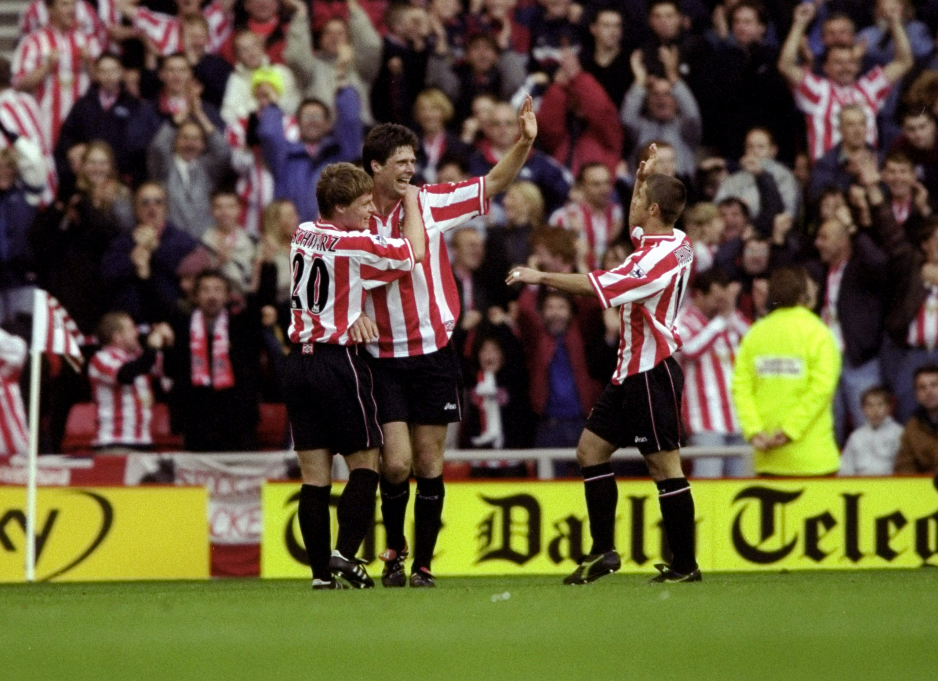 31 Oct 1999:  Niall Quinn of Sunderland celebrates his goal against Tottenham Hotspur with team mates Stefan Schwarz and Kevin Phillips during the FA Carling Premiership match at the Stadium of Light in Sunderland, England. Sunderland won 2-1. \ Mandatory