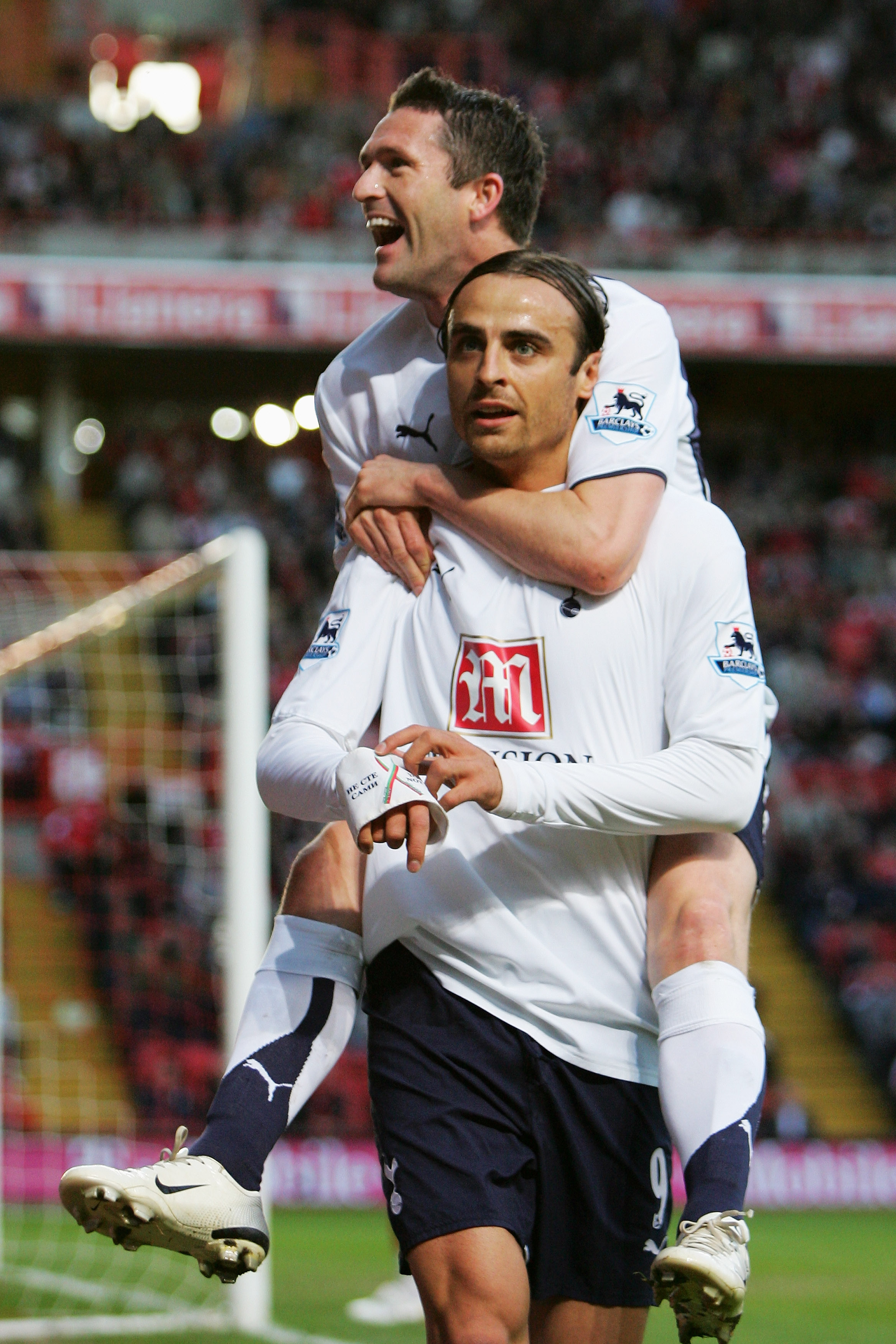 LONDON - MAY 07:  Dimitar Berbatov of Tottenham Hotspur is congratulated by team mate Robbie Keane after he scores the first goal of the game during the Barclays Premiership match between Charlton Athletic and Tottenham Hotspur at The Valley on May 7, 200