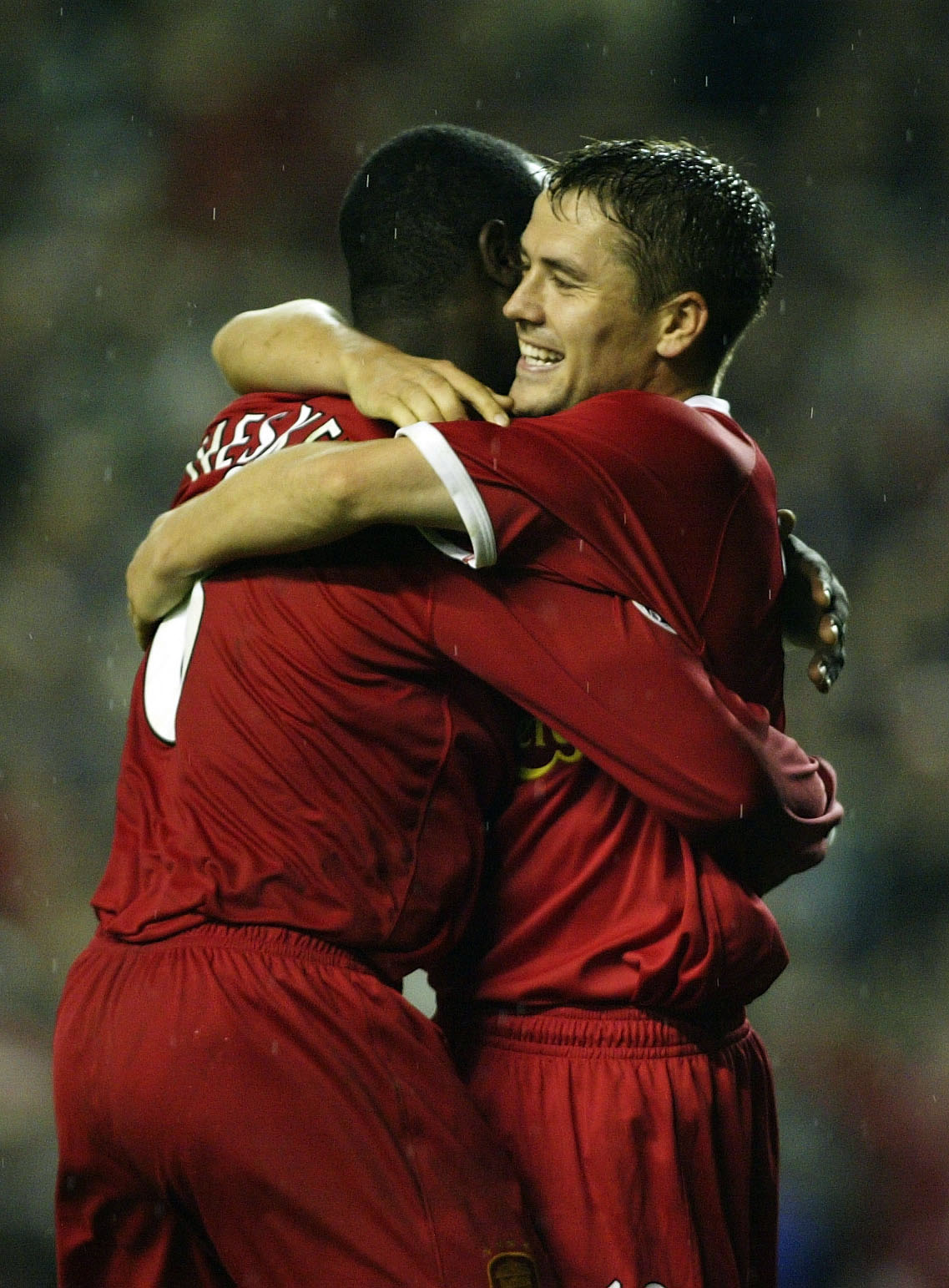 LIVERPOOL - OCTOBER 2:  Emile Heskey of Liverpool celebrates with Michael Owen after scoring the fifth goal during the Liverpool v Spartak Moscow UEFA Champions League phase one, Group B match at Anfield on October 2, 2002 in Liverpool, England. (Photo by