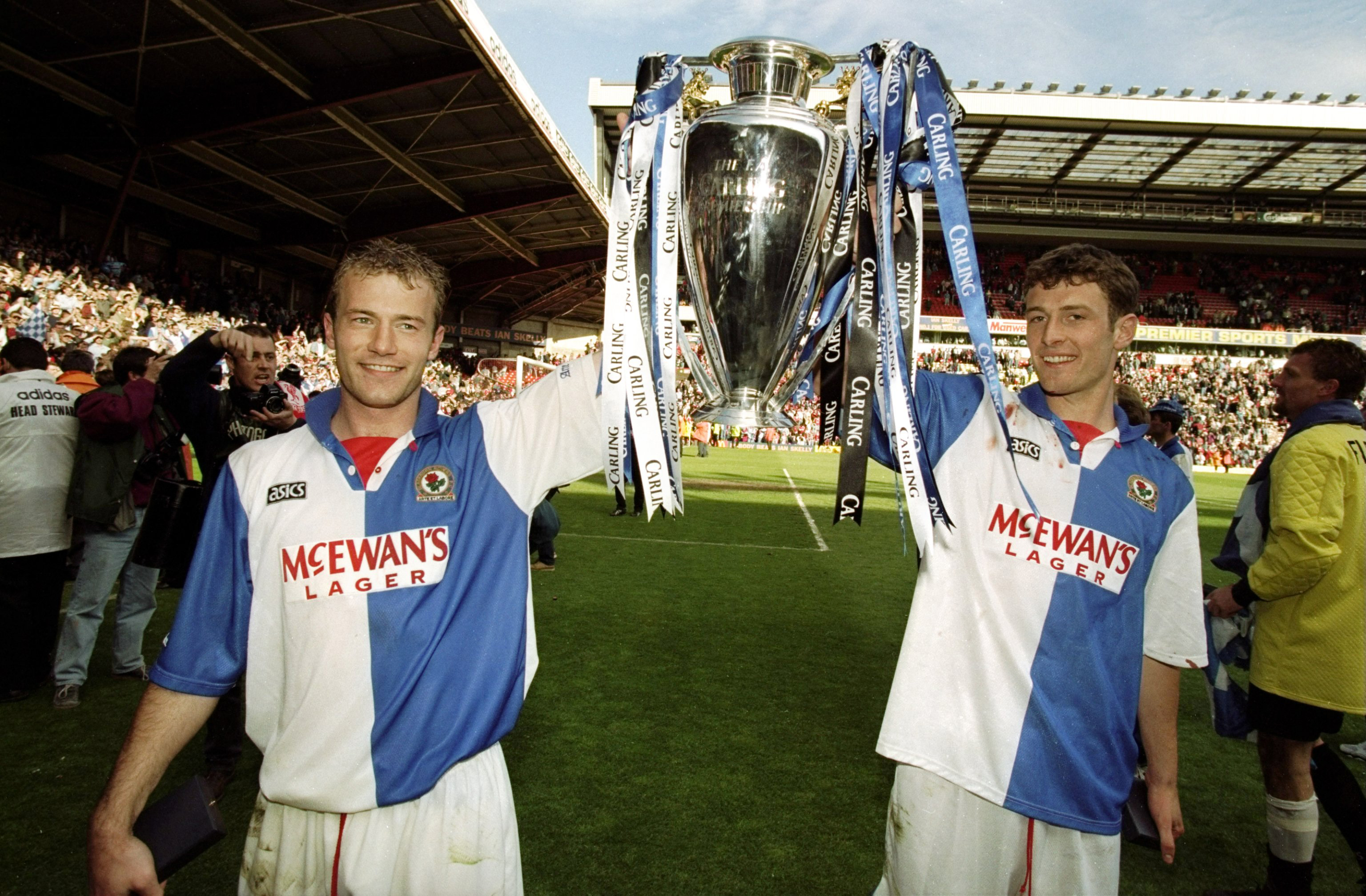 14 May 1998:  Alan Shearer and Chris Sutton of Blackburn Rovers celebrate with the Premiership trophy after winning the Premiership title during the FA Carling Premiership match against Liverpool played at Anfield in Liverpool, England.  The match finishe