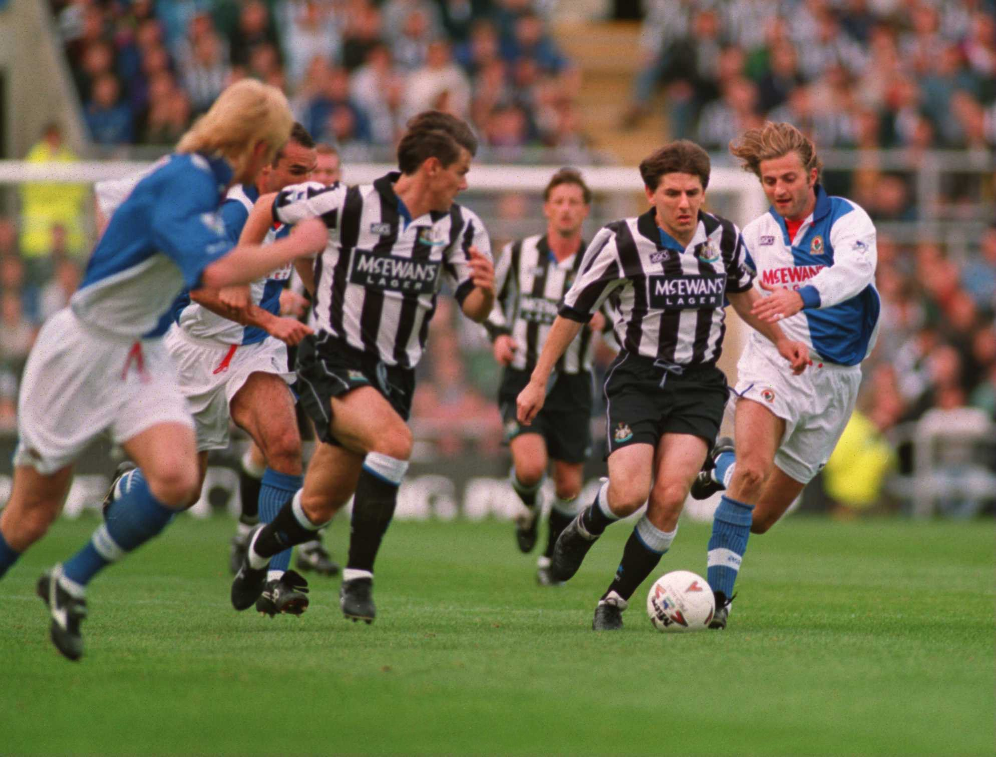 9 OCT 1994:  NEWCASTLE's PETER BEARDSLEY RUNS THROUGH THE MIDDLE OF THE BLACKBURN DEFENCE DURING THE NEWCASTLE UNITED V BLACKBURN ROVERS IN THE FA PREMIERSHIP AT ST. JAMES PARK, NEWCASTLE. Mandatory Credit: Clive Brunskill/ALLSPORT