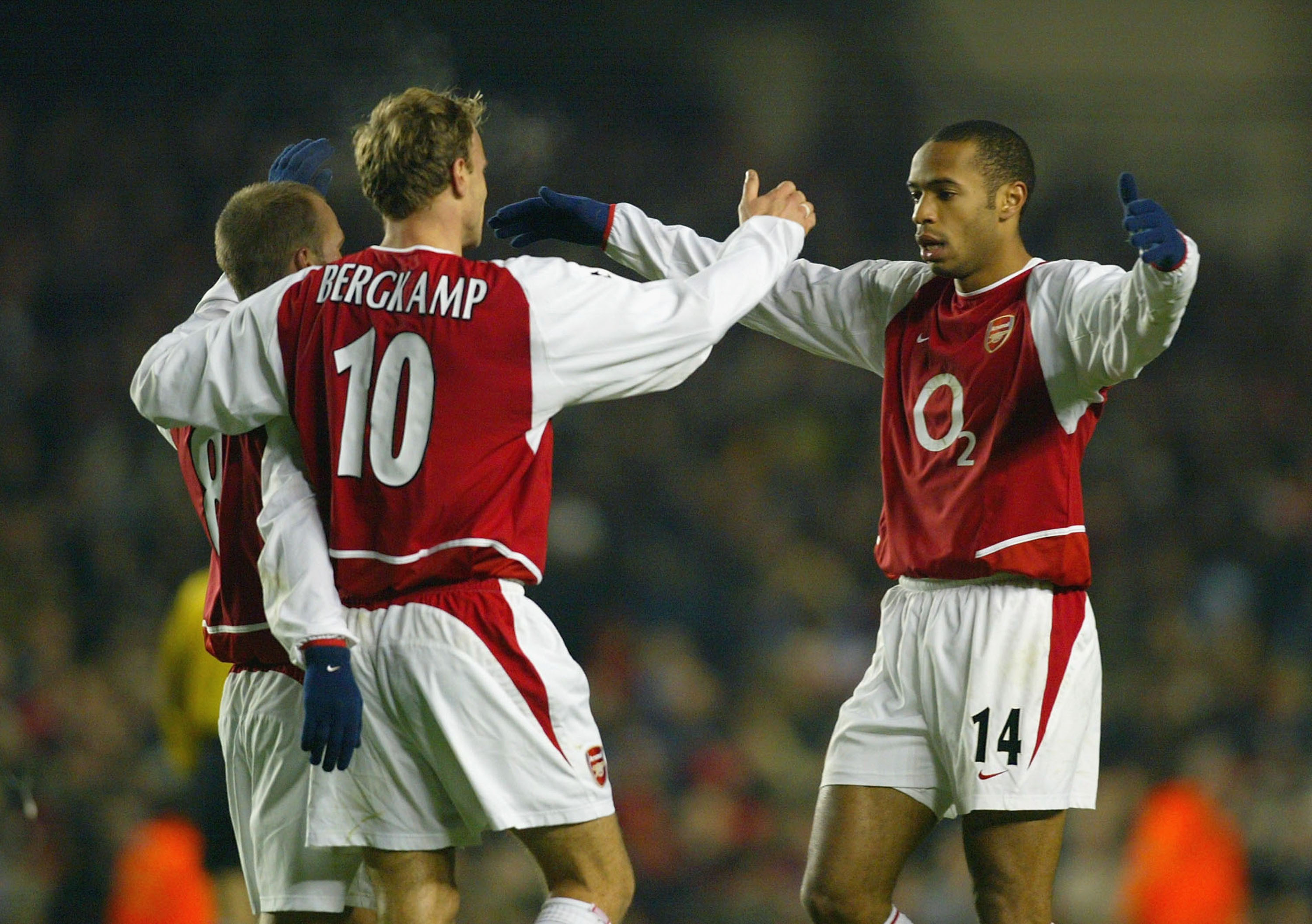LONDON - DECEMBER 10:  Thierry Henry of Arsenal celebrates with Dennis Bergkamp and  Fredrik Ljungberg after Fredrik Ljungberg scored the second goal for Arsenal during the UEFA Champions League Group B match between Arsenal and Lokomotiv Moscow at Highbu