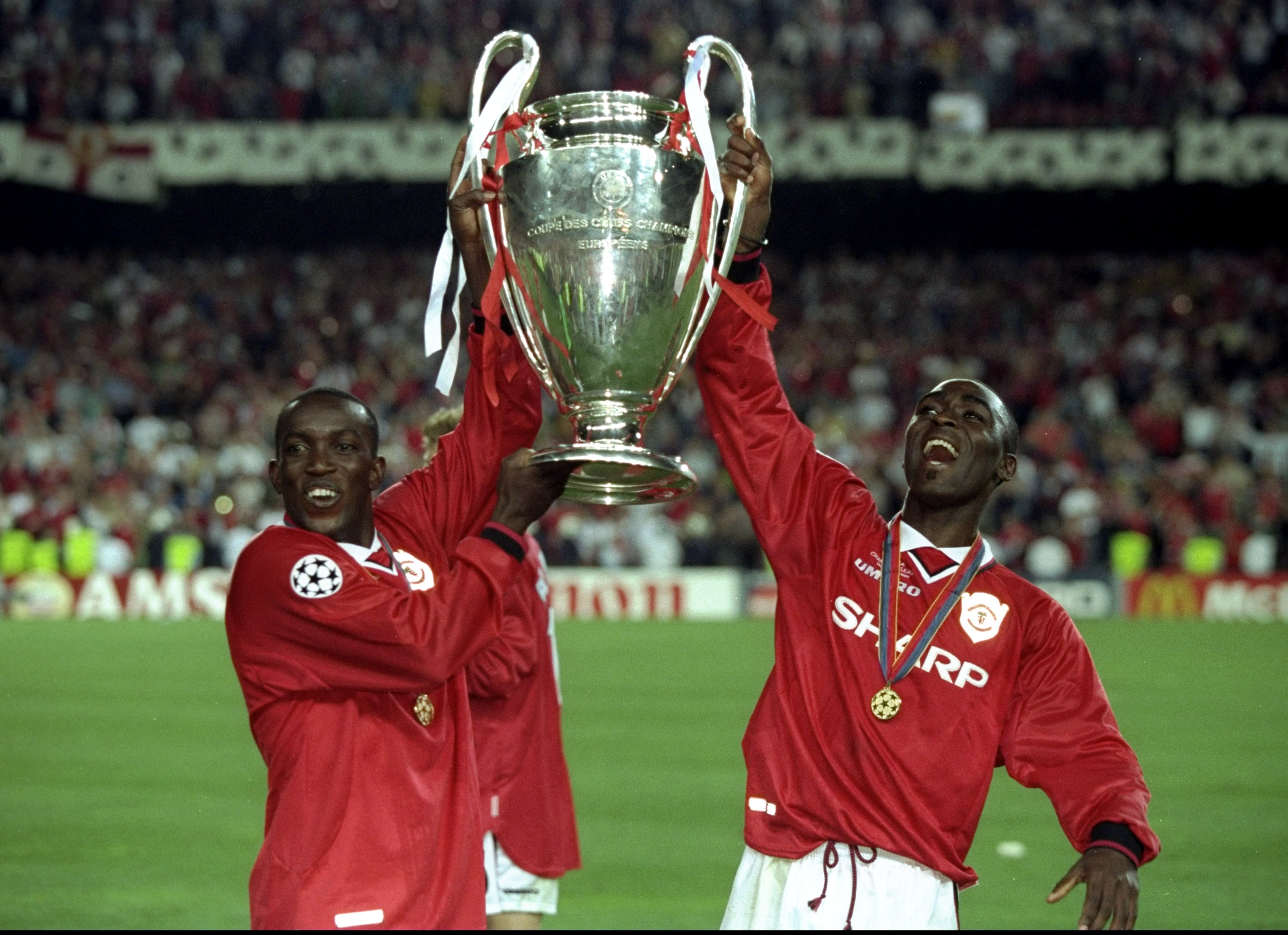 26 May 1999:  Dwight Yorke and Andy Cole of Manchester United lift the trophy after a 2-1 victory over Bayern Munich in the UEFA Champions League Final at the Nou Camp in Barcelona, Spain.  \ Mandatory Credit: Alex Livesey /Allsport