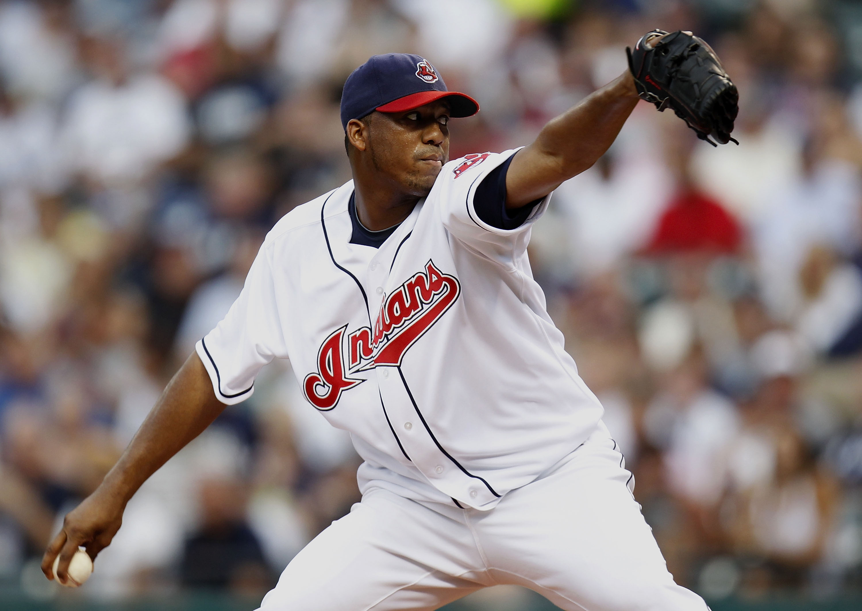 CLEVELAND - JULY 28:  Fausto Carmona #55 of the Cleveland Indians throws a first inning pitch while playing the New York Yankees on July 28, 2010 at Progressive Field in Cleveland, Ohio.  (Photo by Gregory Shamus/Getty Images)