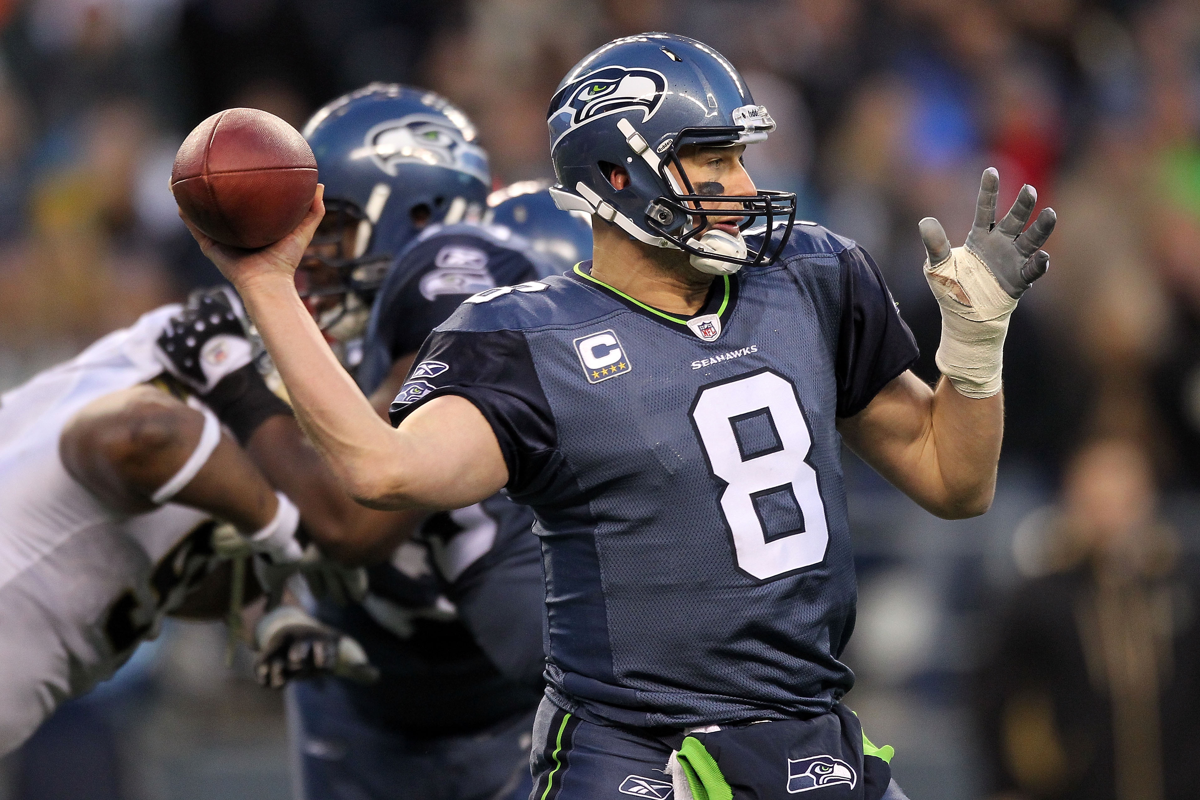 SEATTLE, WA - JANUARY 08:  Quarterback Matt Hasselbeck #8 of the Seattle Seahawks throws the ball in the second half against the New Orleans Saints during the 2011 NFC wild-card playoff game at Qwest Field on January 8, 2011 in Seattle, Washington.  (Phot