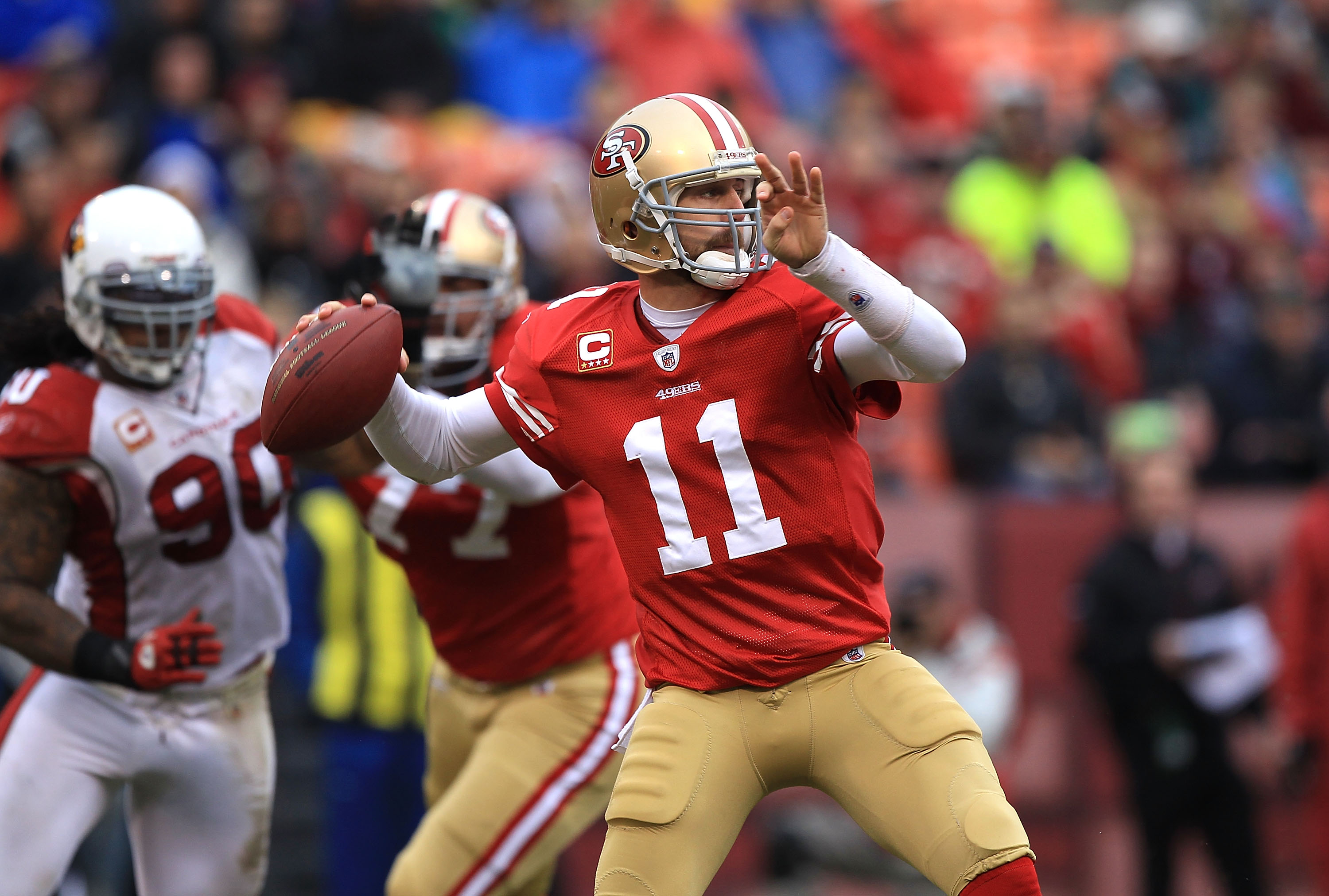 SAN FRANCISCO, CA - JANUARY 2:  Alex Smith #11 of the San Francisco 49ers passes against the Arizona Cardinals during an NFL game at Candlestick Park on January 2, 2011 in San Francisco, California.(Photo by Jed Jacobsohn/Getty Images)