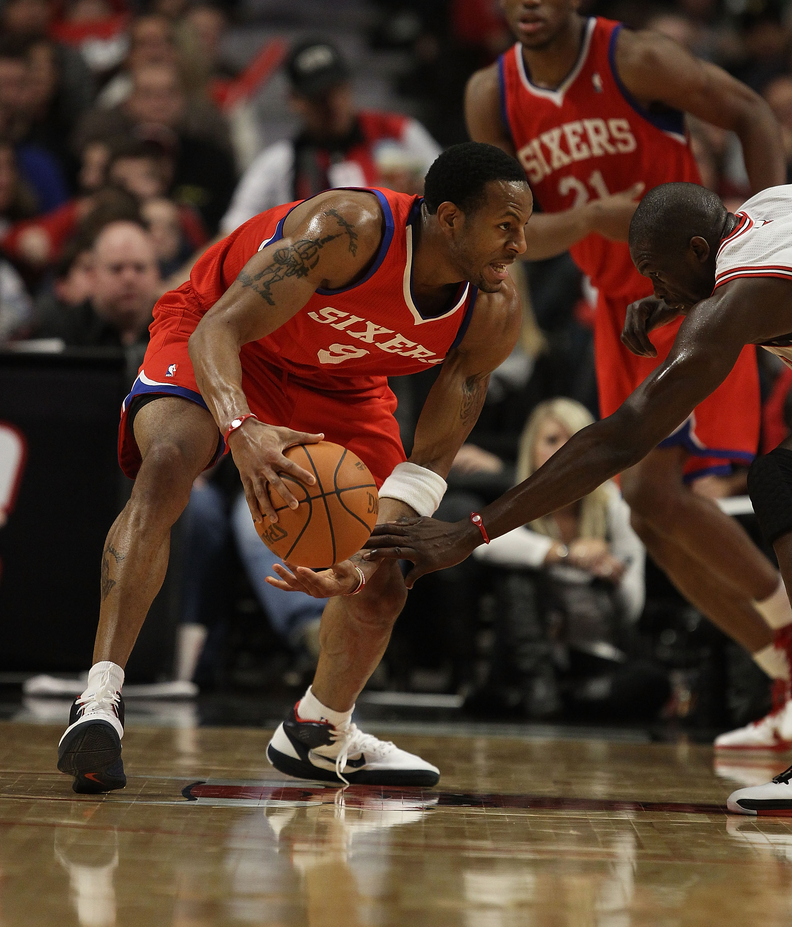 CHICAGO, IL - DECEMBER 21: Andre Iguodala #9 of the Philadelphia 76ers tries to move against Loul Deng #9 of the Chicago Bulls at the United Center on December 21, 2010 in Chicago, Illinois. The Bulls defeated the 76ers 121-76. NOTE TO USER: User expressl