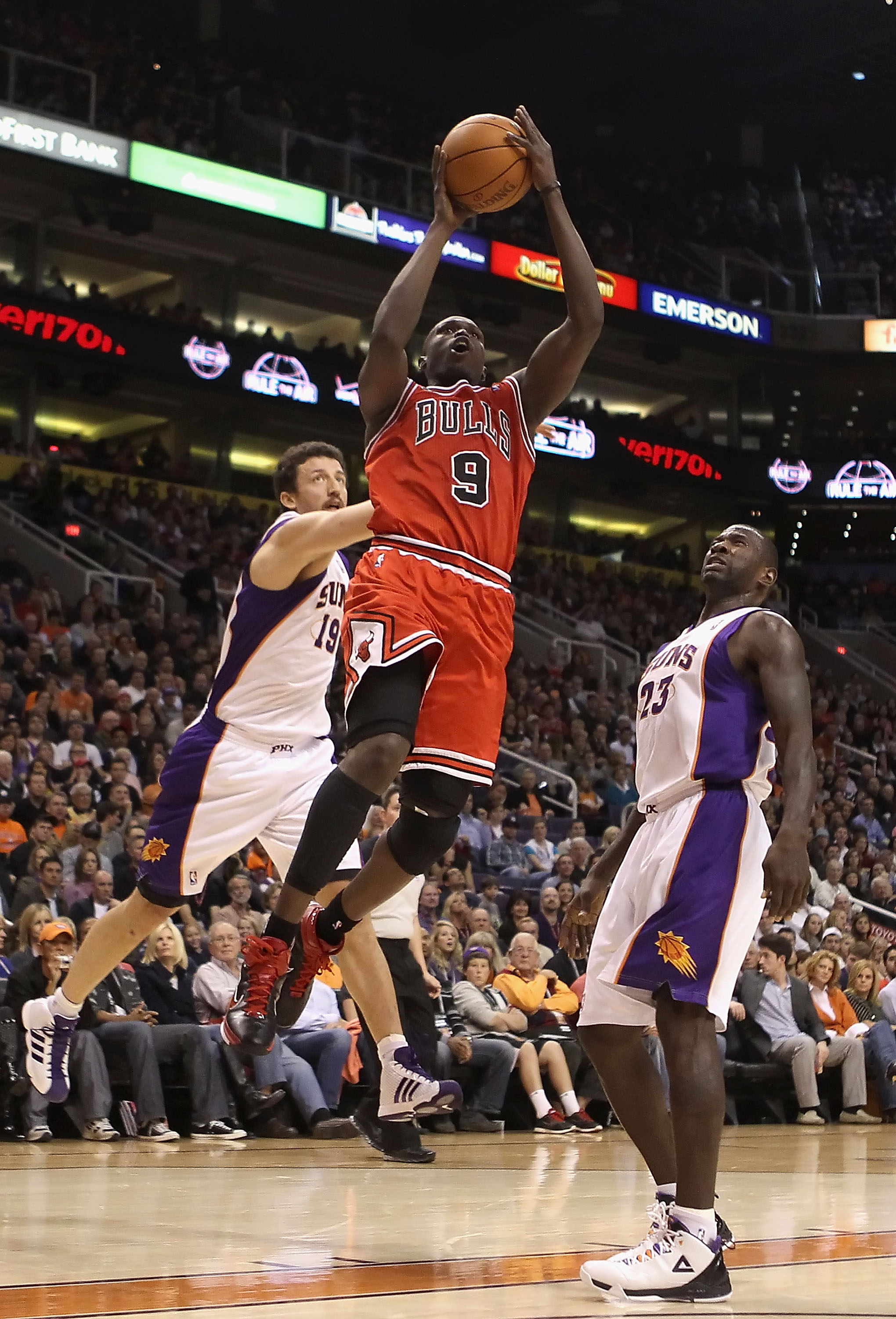 PHOENIX - NOVEMBER 24:  Luol Deng #9 of the Chicago Bulls puts up a shot during the NBA game against the Phoenix Suns at US Airways Center on November 24, 2010 in Phoenix, Arizona. The Bulls defeated the Suns 123-115 in double overtime.  NOTE TO USER: Use