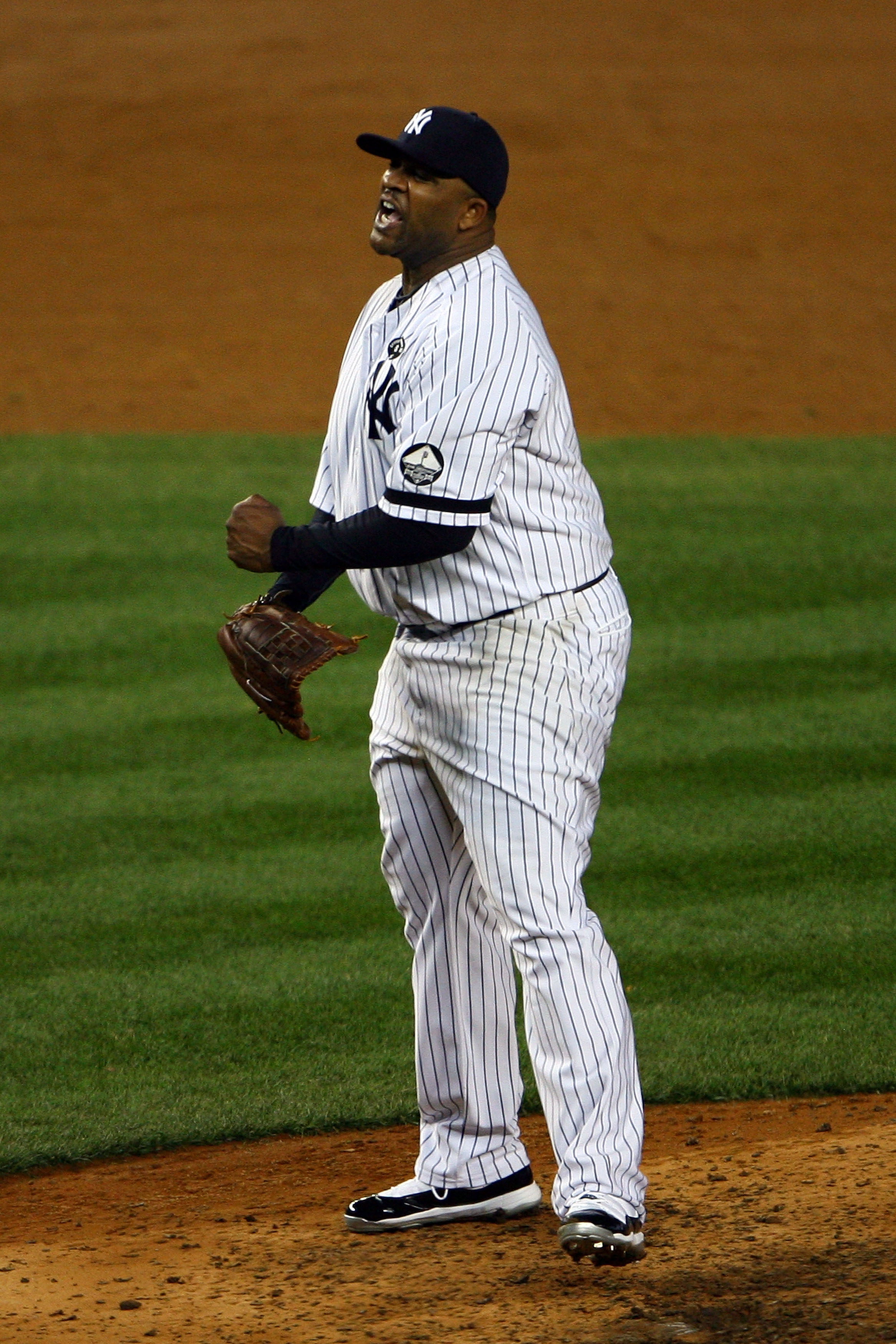 NEW YORK - OCTOBER 20:  CC Sabathia #52 of the New York Yankees reacts after he struck out Mitch Moreland #18 of the Texas Rangers to end the top of the sixth inning of Game Five of the ALCS during the 2010 MLB Playoffs at Yankee Stadium on October 20, 20