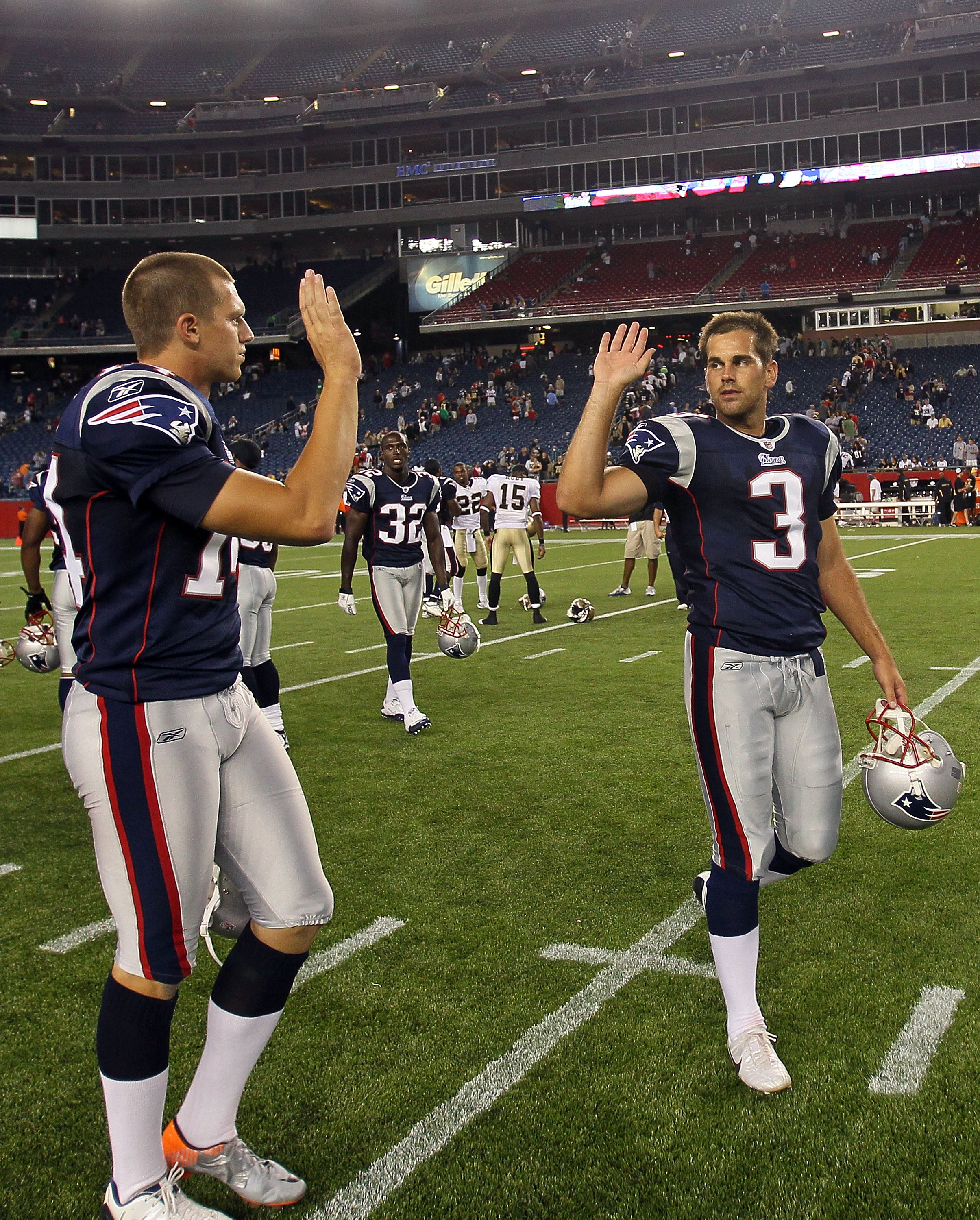 FOXBORO, MA - AUGUST 12: Zoltan Mesko # 14 and Stephen Gostkowski # 3 of the New England Patriots celebrate their 27 - 24 win over the New Orleans Saints at the end of a preseason game at Gillette Stadium on August 12, 2010 in Foxboro, Massachusetts. (Pho