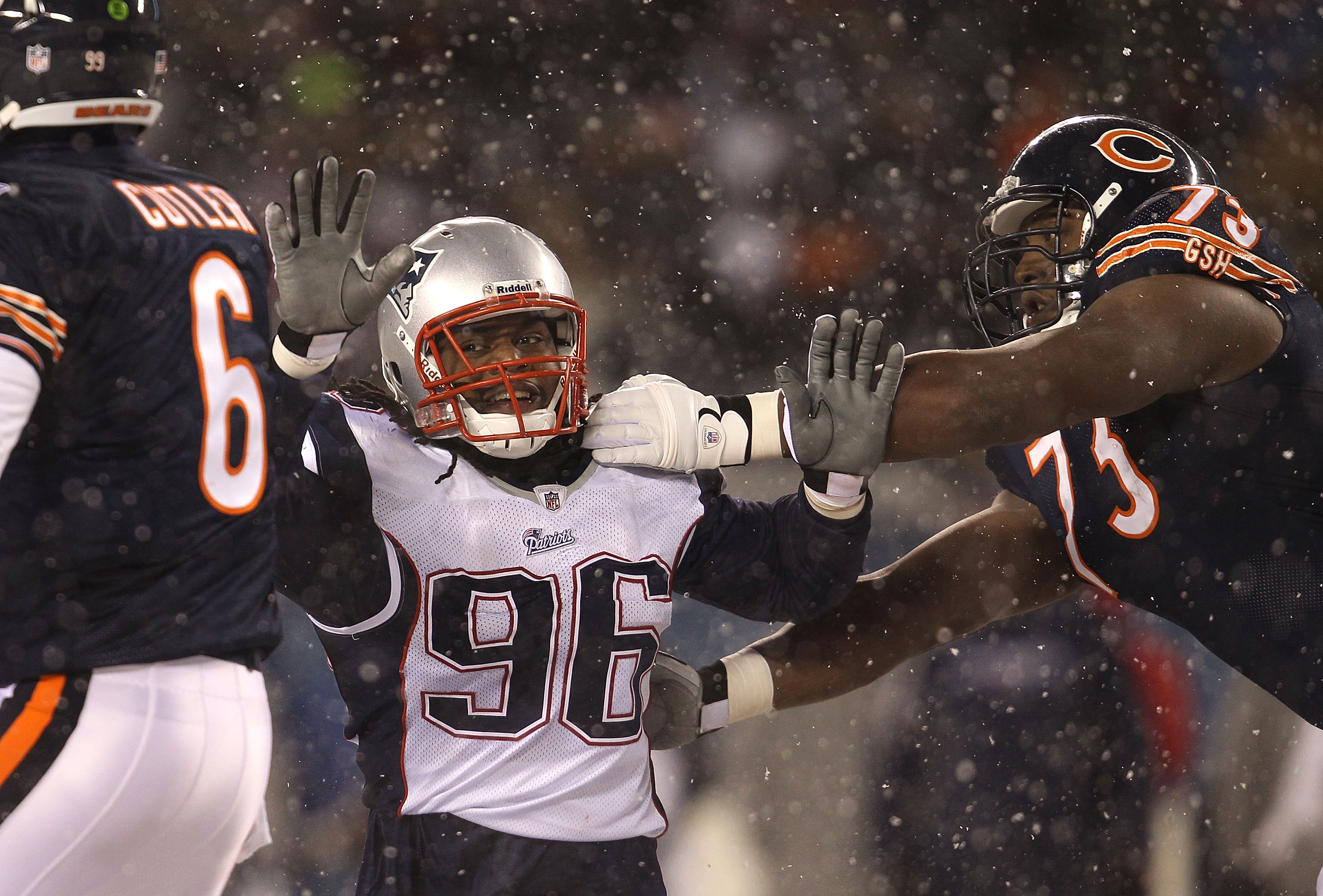 CHICAGO - DECEMBER 12: Jermaine Cunningham #96 of the New England Patriots rushes past J'Marcus Webb #73 of the Chicago Bears towards Jay Cutler #6 at Soldier Field on December 12, 2010 in Chicago, Illinois. The Patriots defeated the Bears 36-7. (Photo by