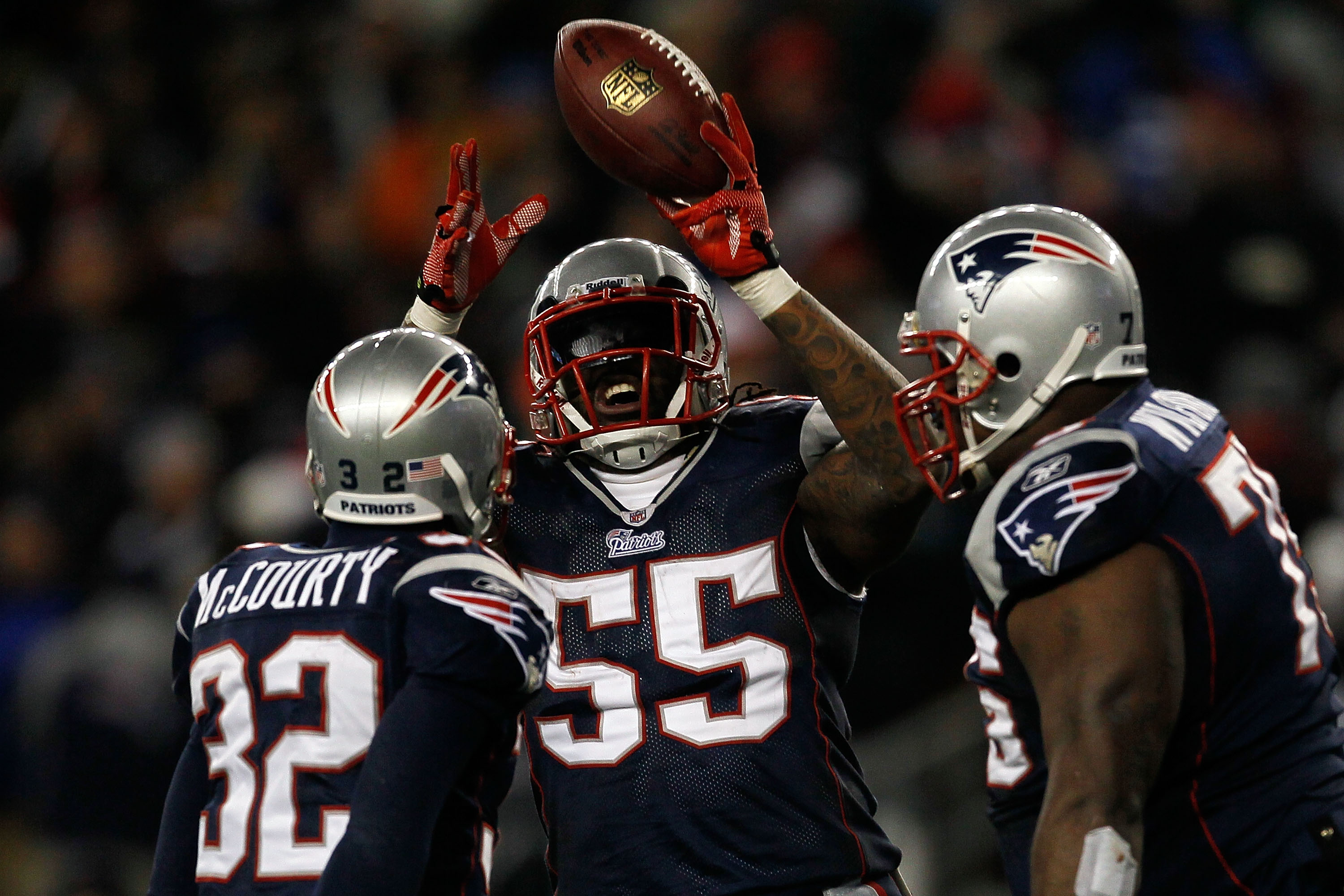 FOXBORO, MA - DECEMBER 06:  (L-R) Devin McCourty #32, Brandon Spikes #55 and Vince Wilfork #75 of the New England Patriots celebrate after McCourty intercepted a pass in the third quarter against the New York Jets at Gillette Stadium on December 6, 2010 i