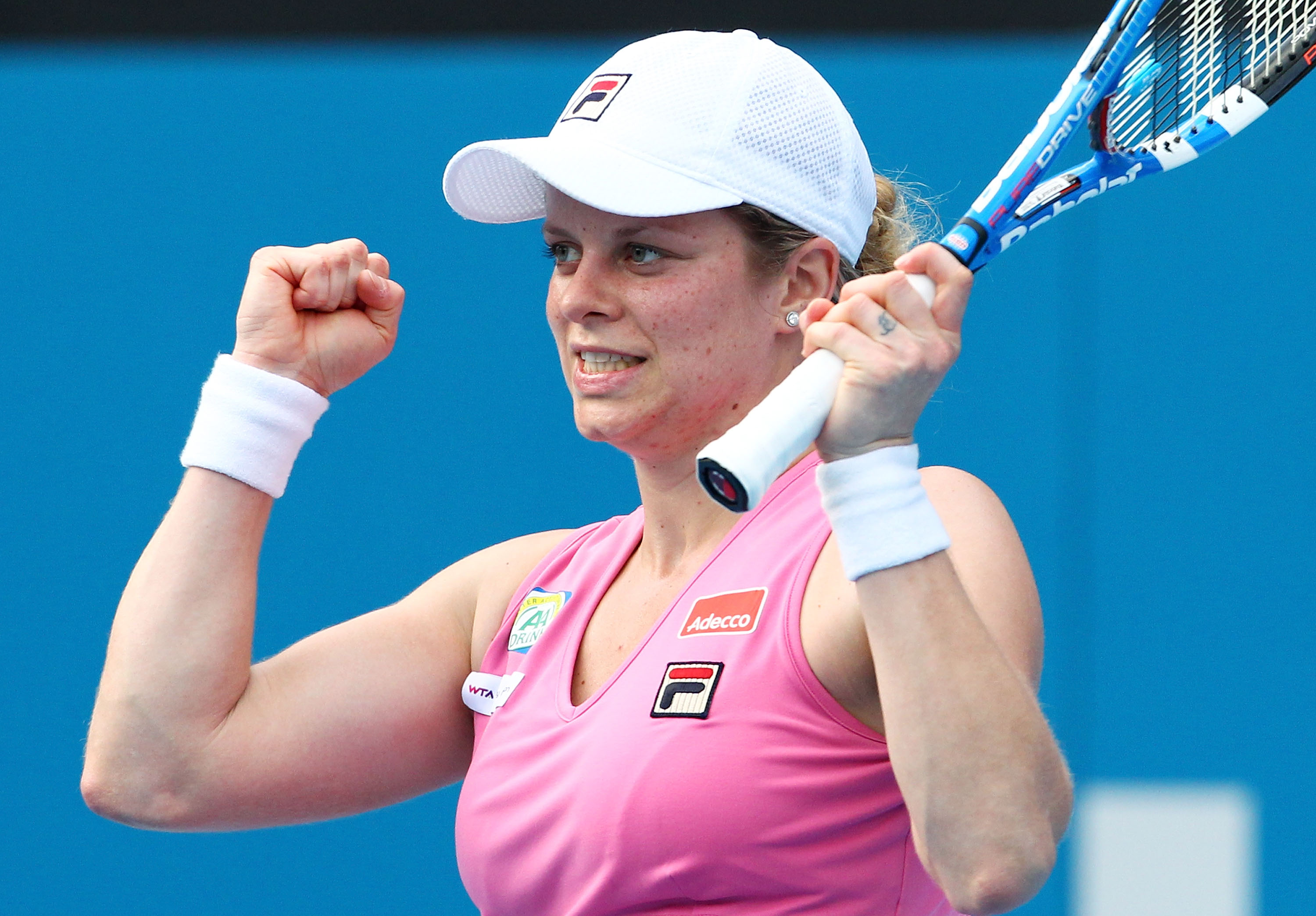 SYDNEY, AUSTRALIA - JANUARY 13:  Kim Clijsters of Belgium celebrates winning her match against Alisa Kleybanova of Russia during day five of the 2011 Medibank International at Sydney Olympic Park Tennis Centre on January 13, 2011 in Sydney, Australia.  (P