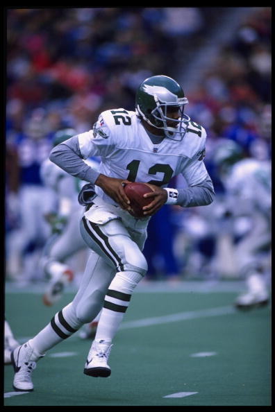 19 Nov 1995:  Quarterback Randall Cunningham #12 of the Philadelphia Eagles drops back for center during the Eagles 28-19 victory over the New York Giants at Veterans Stadium in Philadelphia, Pennsylvania.  Mandatory Credit:  Ken White/Allsport