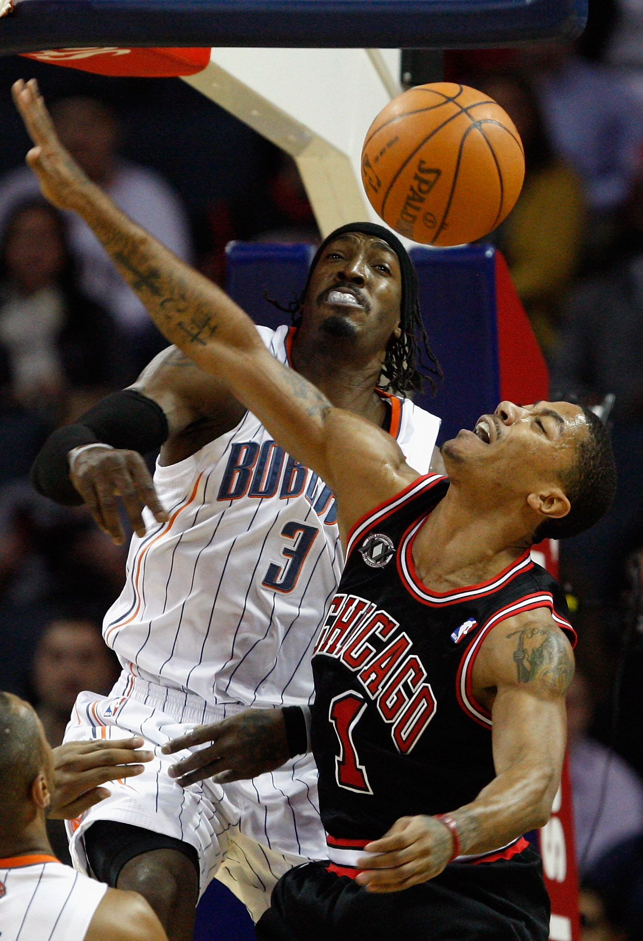 CHARLOTTE, NC - JANUARY 12:  Derrick Rose #1 of the Chicago Bulls has his shot blocked by Gerald Wallace #3 of the Charlotte Bobcats during their game at Time Warner Cable Arena on January 12, 2011 in Charlotte, North Carolina. NOTE TO USER: User expressl