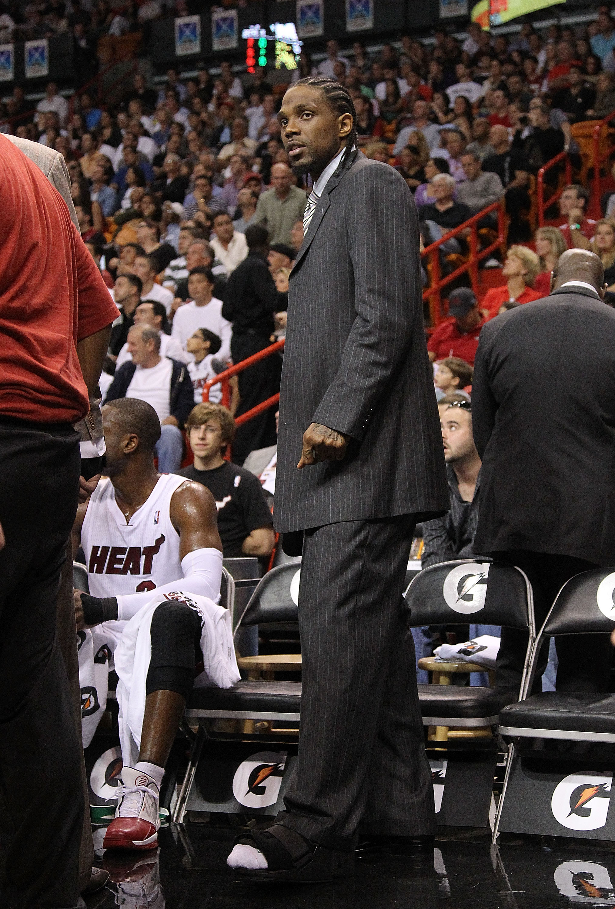 MIAMI - NOVEMBER 22: Udonis Haslem #40 of the Miami Heat waits on the sidlines with an injured foot before having surgery during a game against the Indiana Pacers at American Airlines Arena on November 22, 2010 in Miami, Florida. NOTE TO USER: User expres