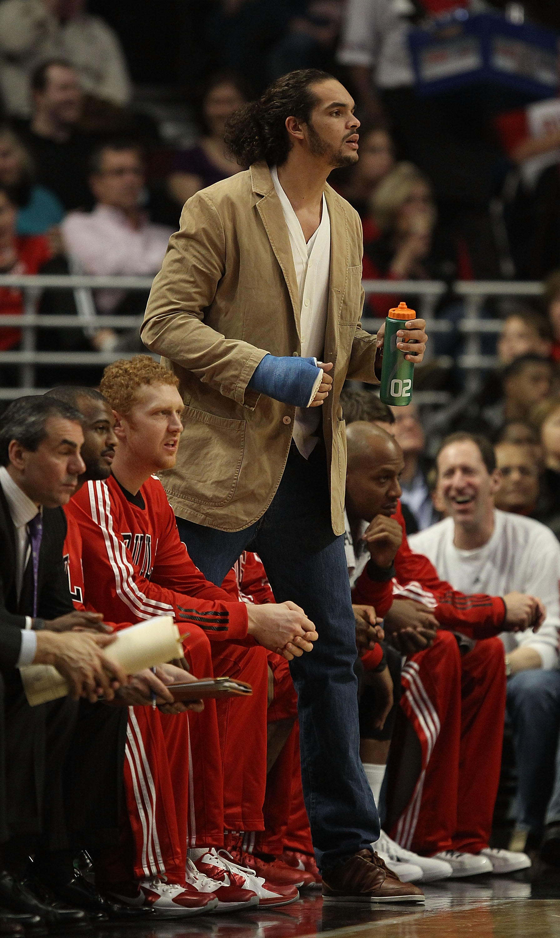 CHICAGO, IL - DECEMBER 21: Injured player Joakim Noah of the Chicago Bulls watches as his teammates take on the Philadelphia 76ers at the United Center on December 21, 2010 in Chicago, Illinois. The Bulls defeated the 76ers 121-76. NOTE TO USER: User expr