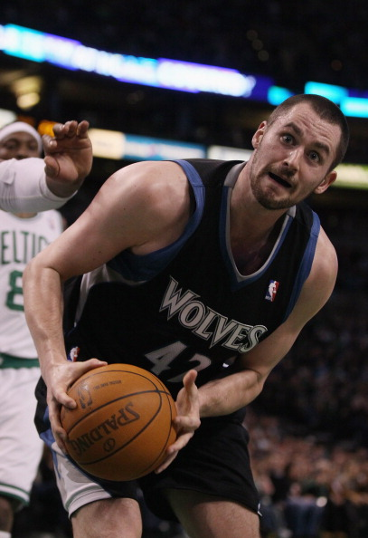 BOSTON, MA - JANUARY 03:  Kevin Love #42 of the Minnesota Timberwolves grabs the rebound in the first half against the Boston Celtics on January 3, 2011 at the TD Garden in Boston, Massachusetts. NOTE TO USER: User expressly acknowledges and agrees that,