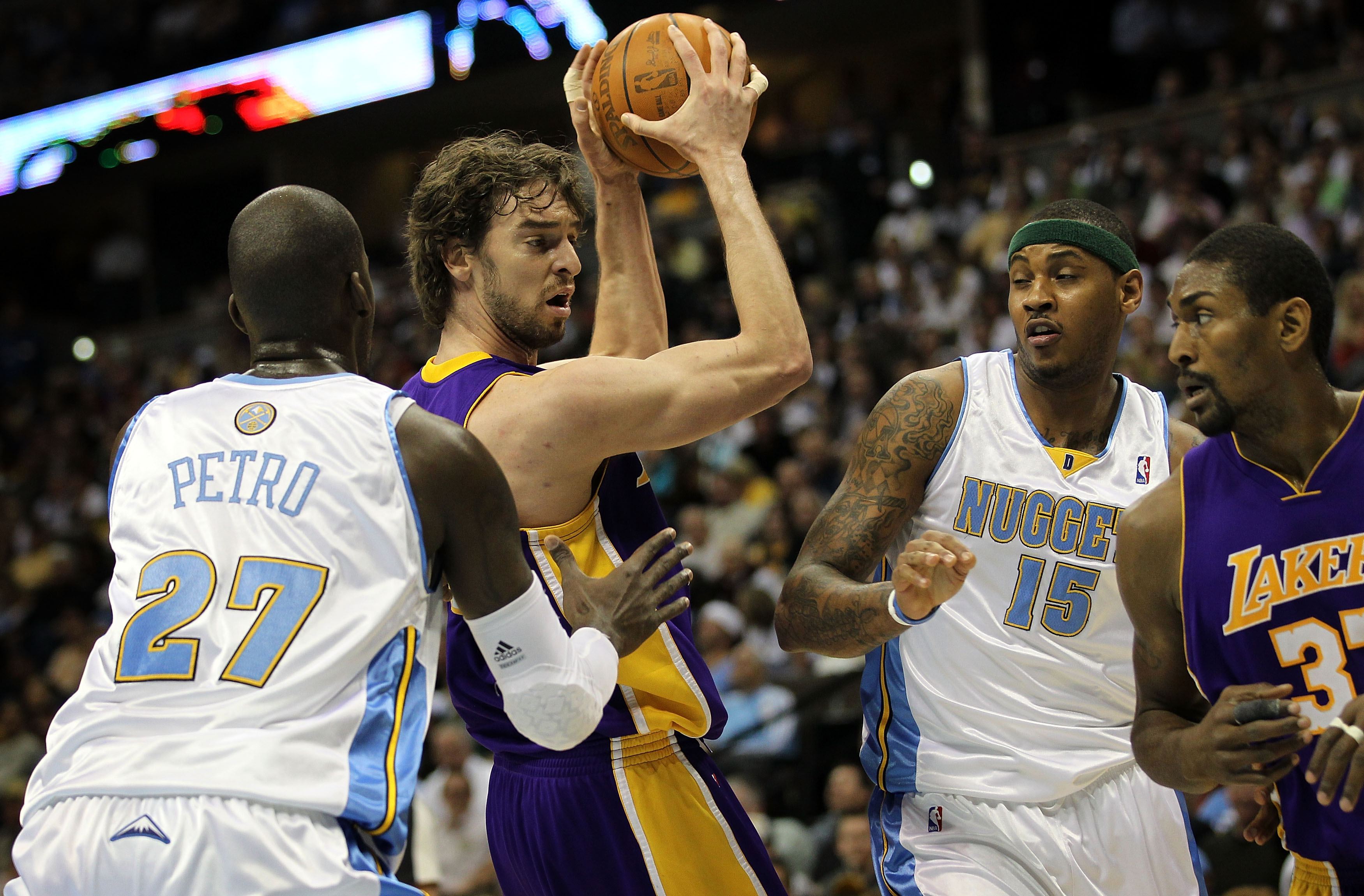 DENVER - APRIL 08:  Pau Gasol #16 of the Los Angeles Lakers controls the ball as Johan Petro #27 of the Denver Nuggets defends while Carmelo Anthony #15 of the Nuggets defends against Ron Artest #37 of the Lakers during NBA action at the Pepsi Center on A